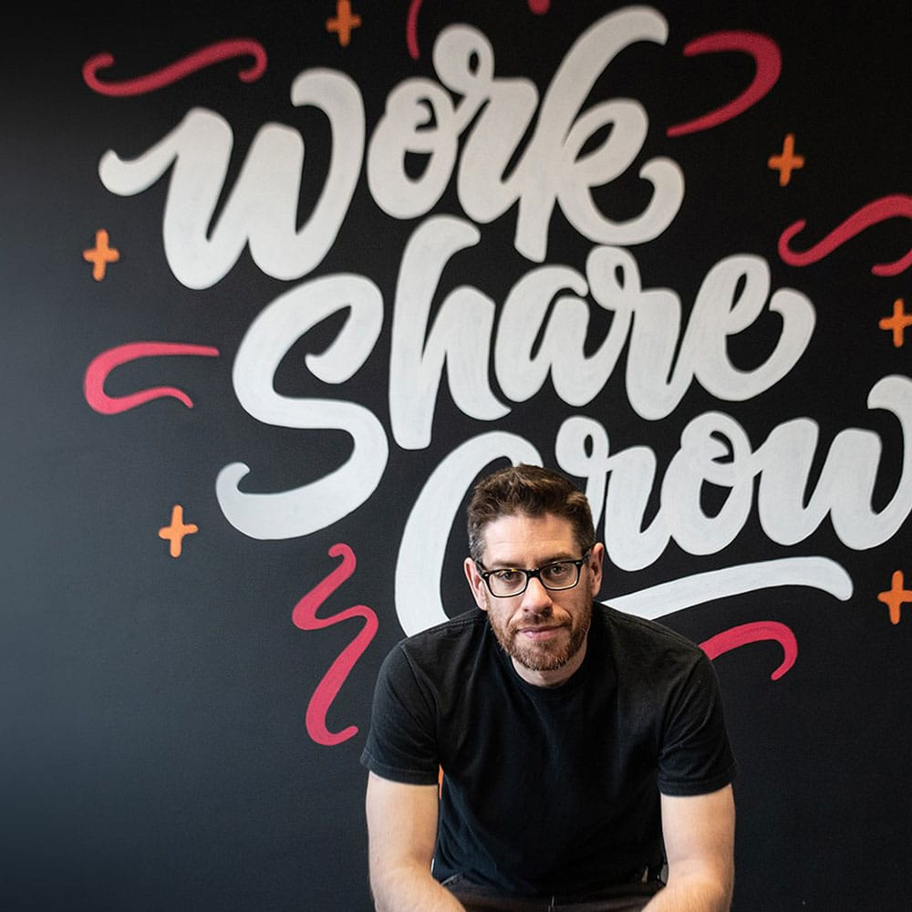"Ian Barnard - Educraytor • Reppin EnglandIan is a UK-based calligrapher, hand letterer, type designer and newbie muralist. His love for lettering started when he got a copy of ""Calligraphy for Dummies"" 5 years ago and now pursues his passion full time through custom lettering for brands, selling fonts and digital products and teaching others through short Instagram and YouTube videos. He uses both analogue and digital media, finding anything and everything he can get his hands on to letter with or on. Passionate to see other people pick up his love for letters and that learning calligraphy still hasn't sorted out his terrible handwriting.Instagram 