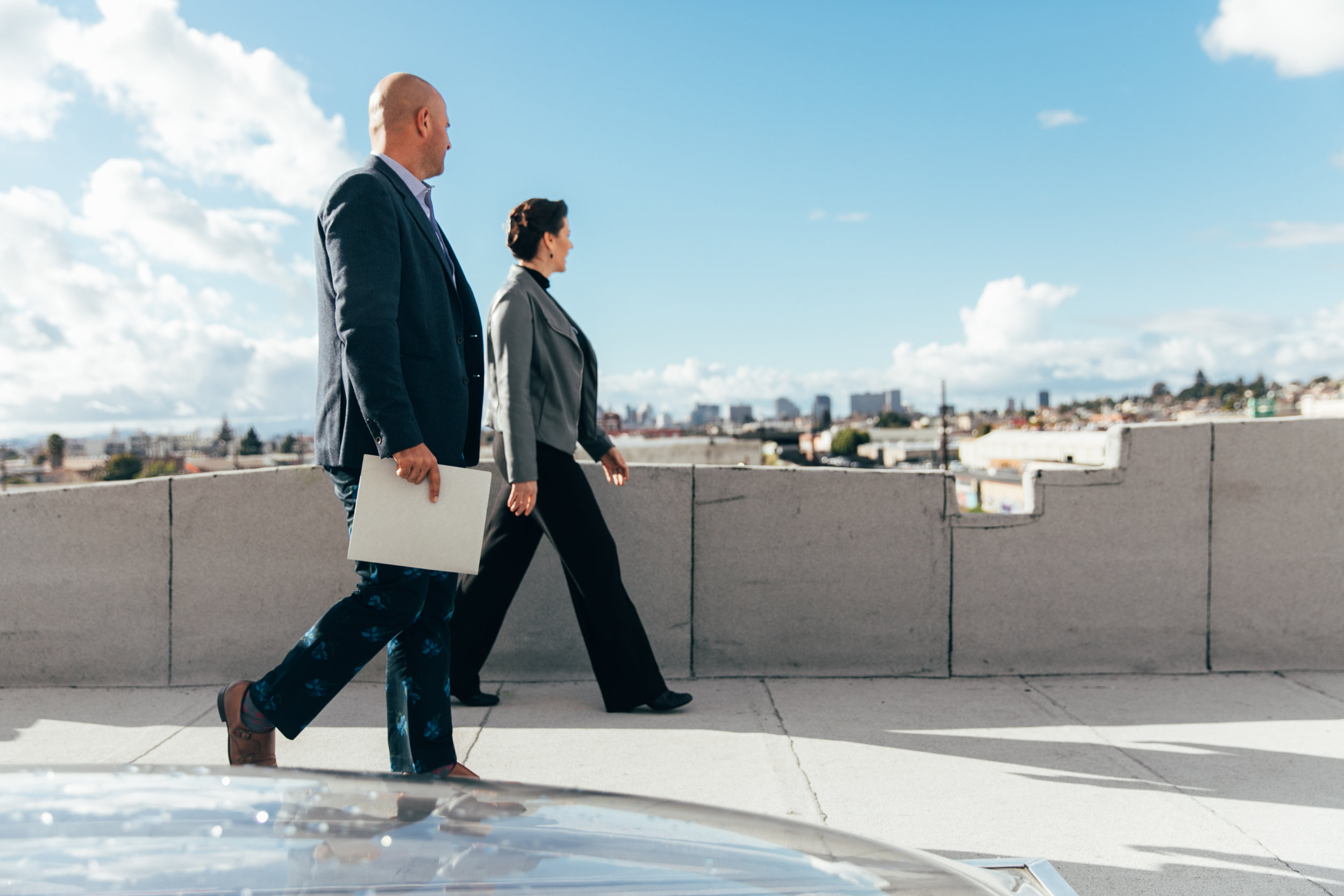 Mayor Libby Schaaf takes in the view from Artthaus Studios' rooftop deck with Riaz Inc founder Riaz Taplin 3.14.18