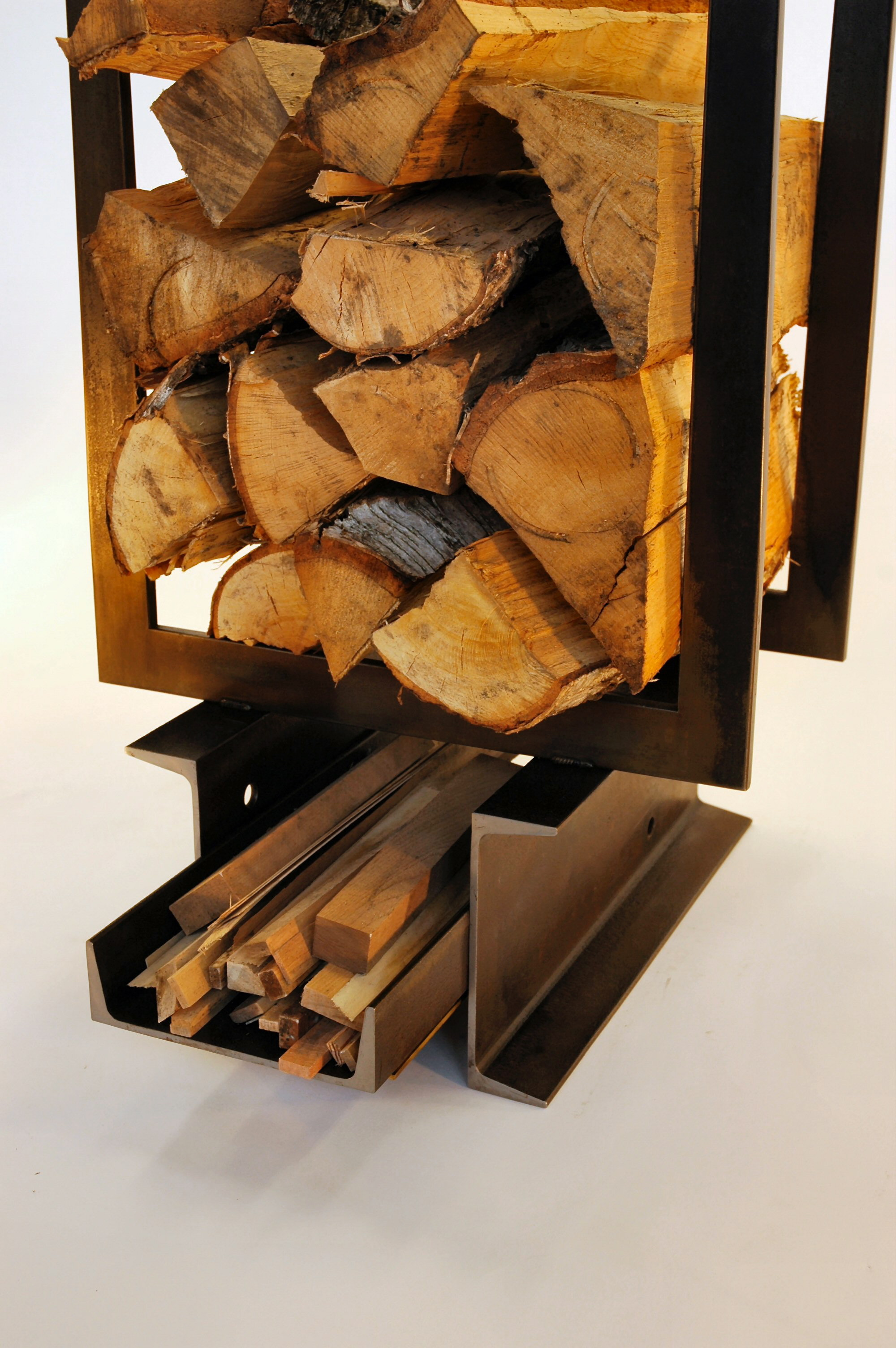 The bottom channel was not structural, it pulled out for easy access to kindling.