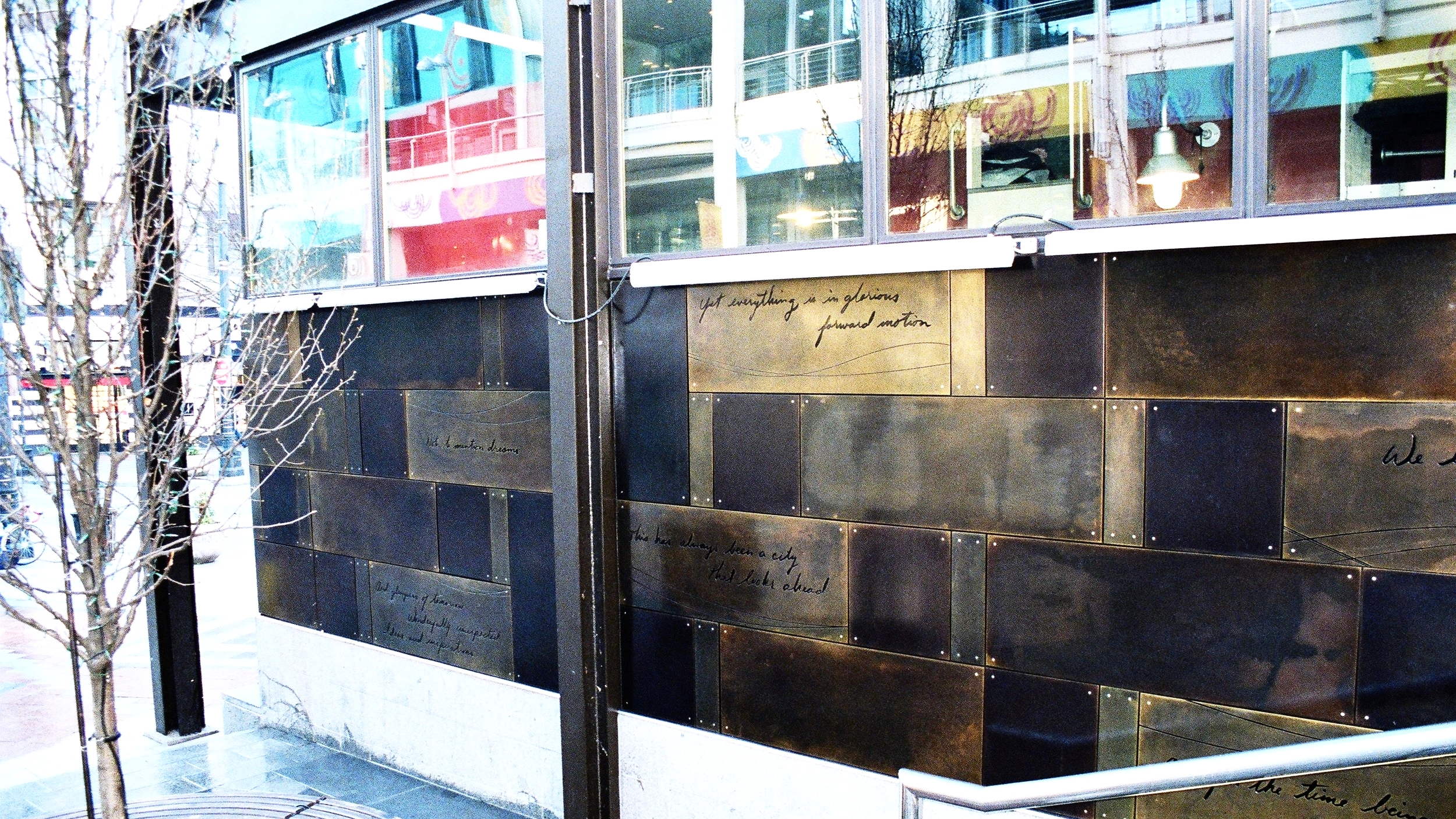 Design, fabrication and install of exterior bronze panels for Starbucks Coffee, Westlake Center, Seattle. The panels are etched and patinated naval bronze. 1999.