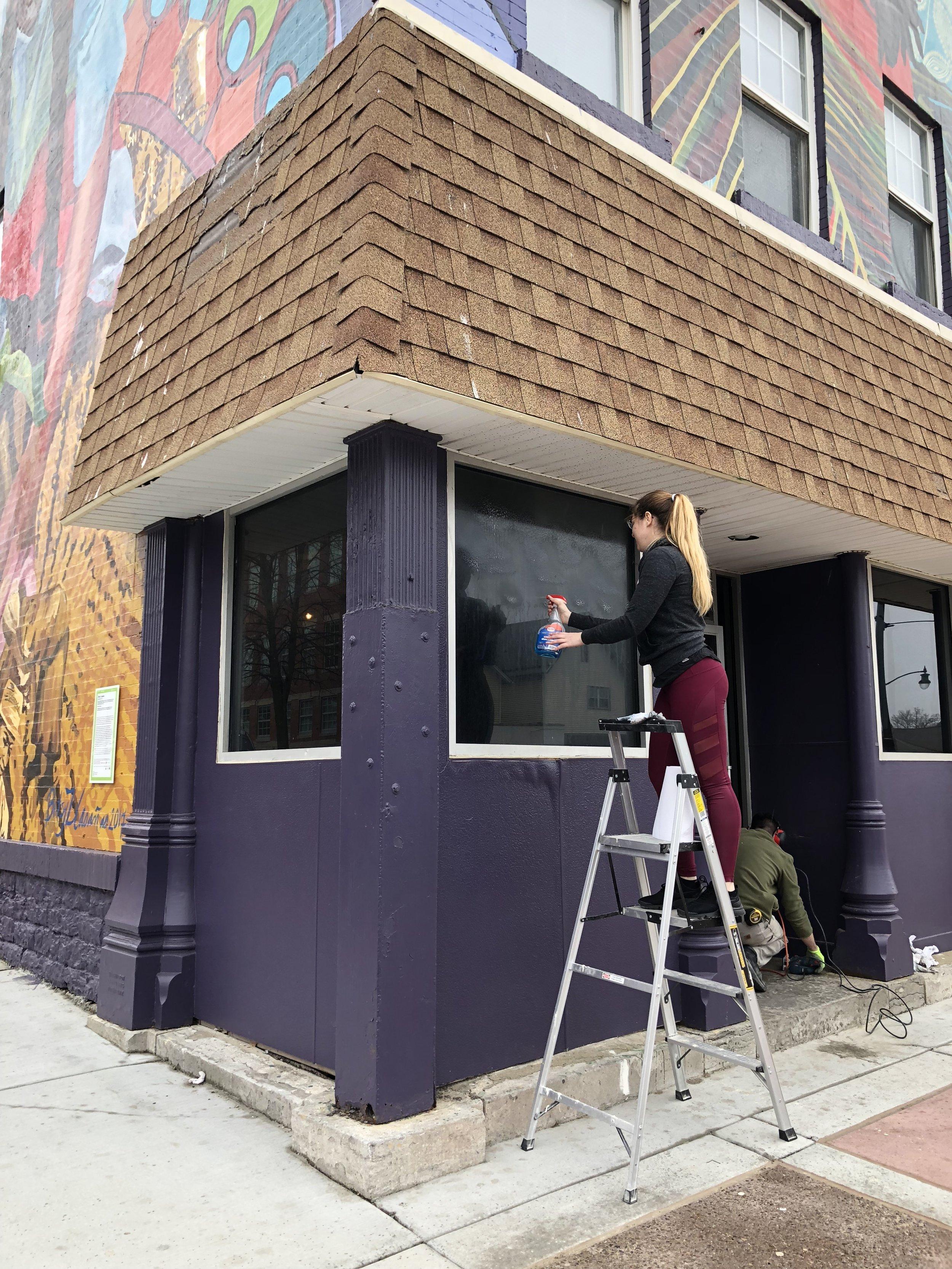 Austin cleaning the new windows.JPG