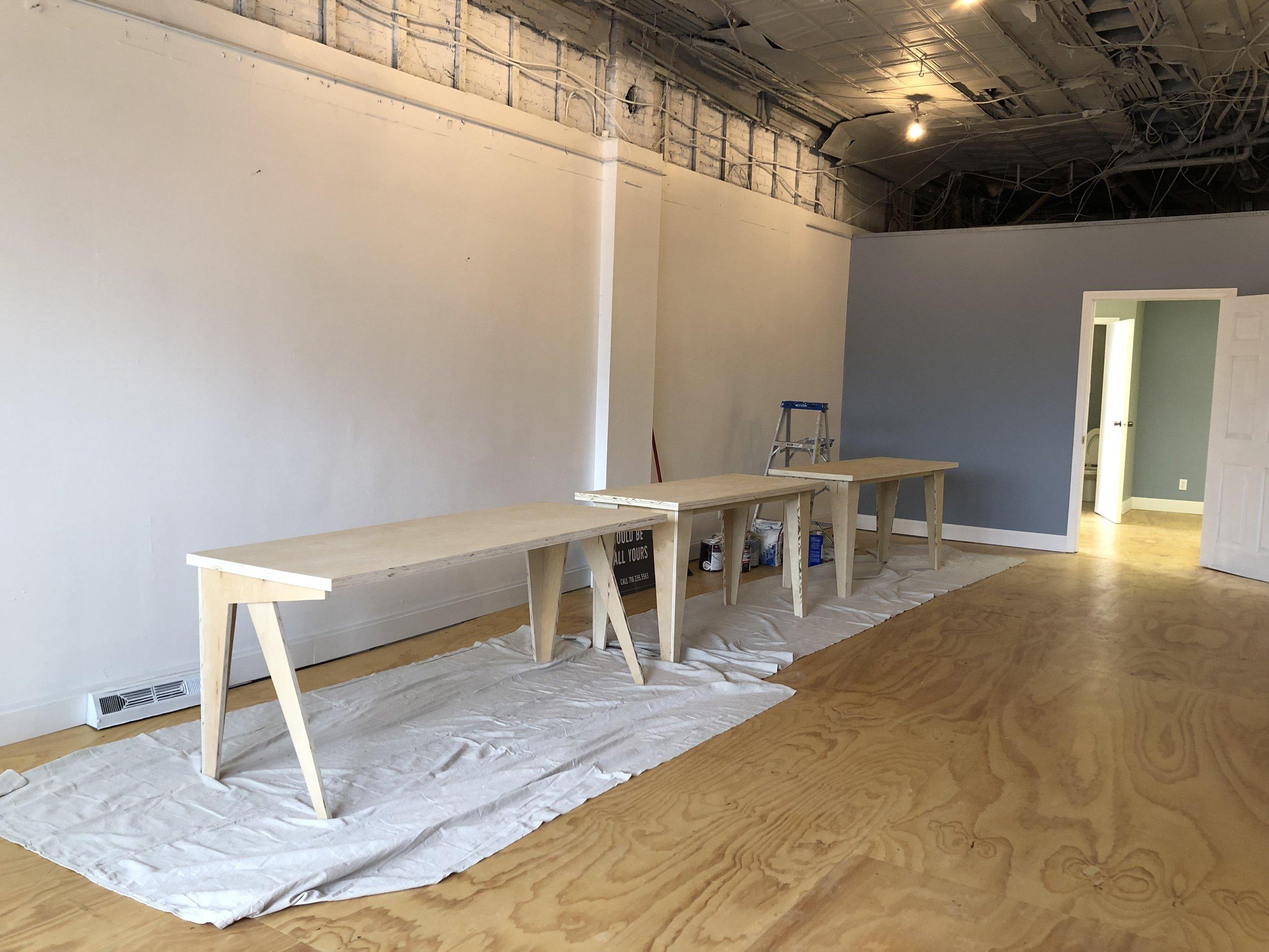 niagara street getting settled in new desks made.JPG