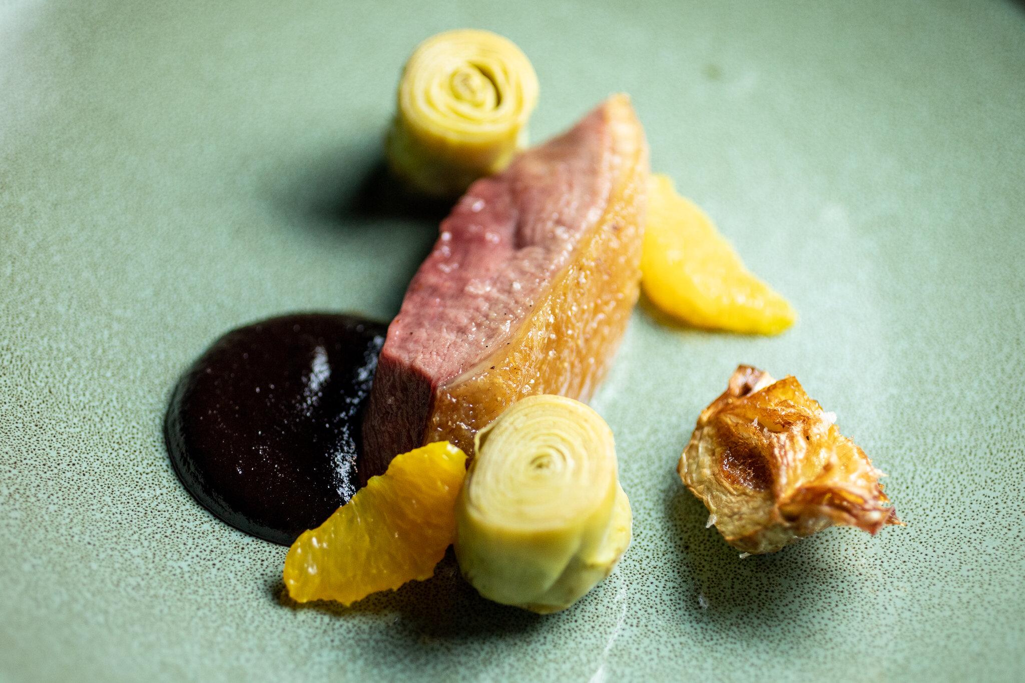 Duck à l'Orange, Artichokes Barigoule, Mole Negro