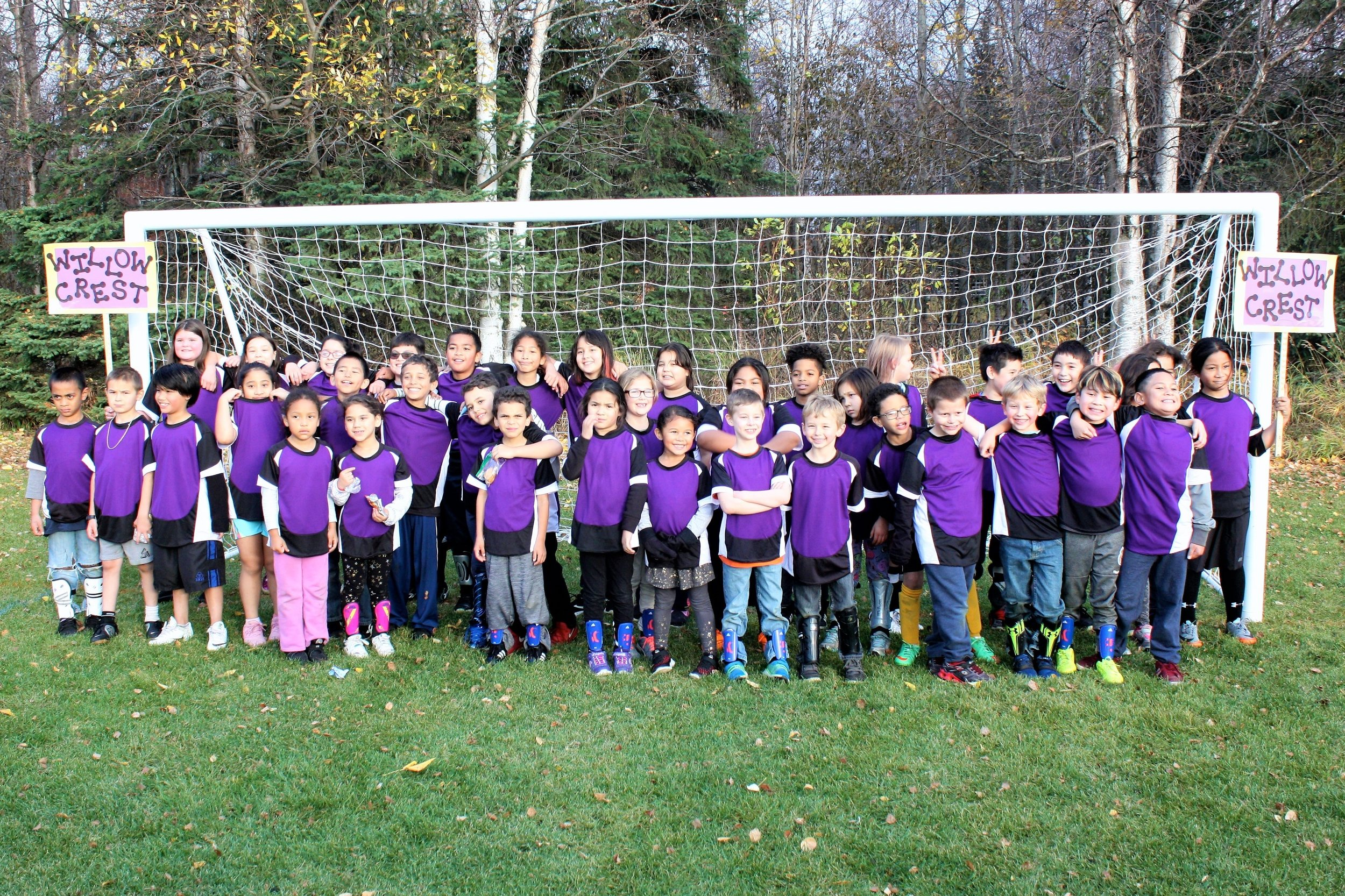 Willowcrest Soccer Team (Grades K-4th) posing as a team in their new soccer uniforms.