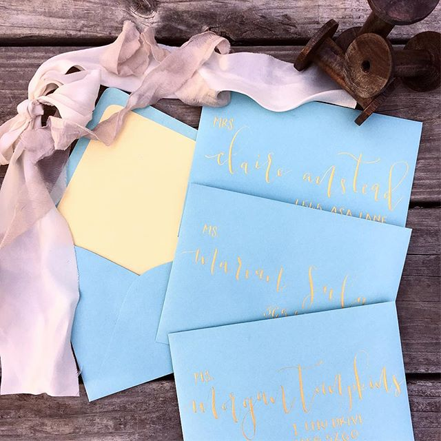 || Light blue and shimmery gold is a perfect match || #aspensandinks #calligraphy #etsy #etsyseller #coloradocalligrapher #weddinginvitations #showerinvitations #babyshowerideas #babyshowerinvites #weddingenvelopes #fineart