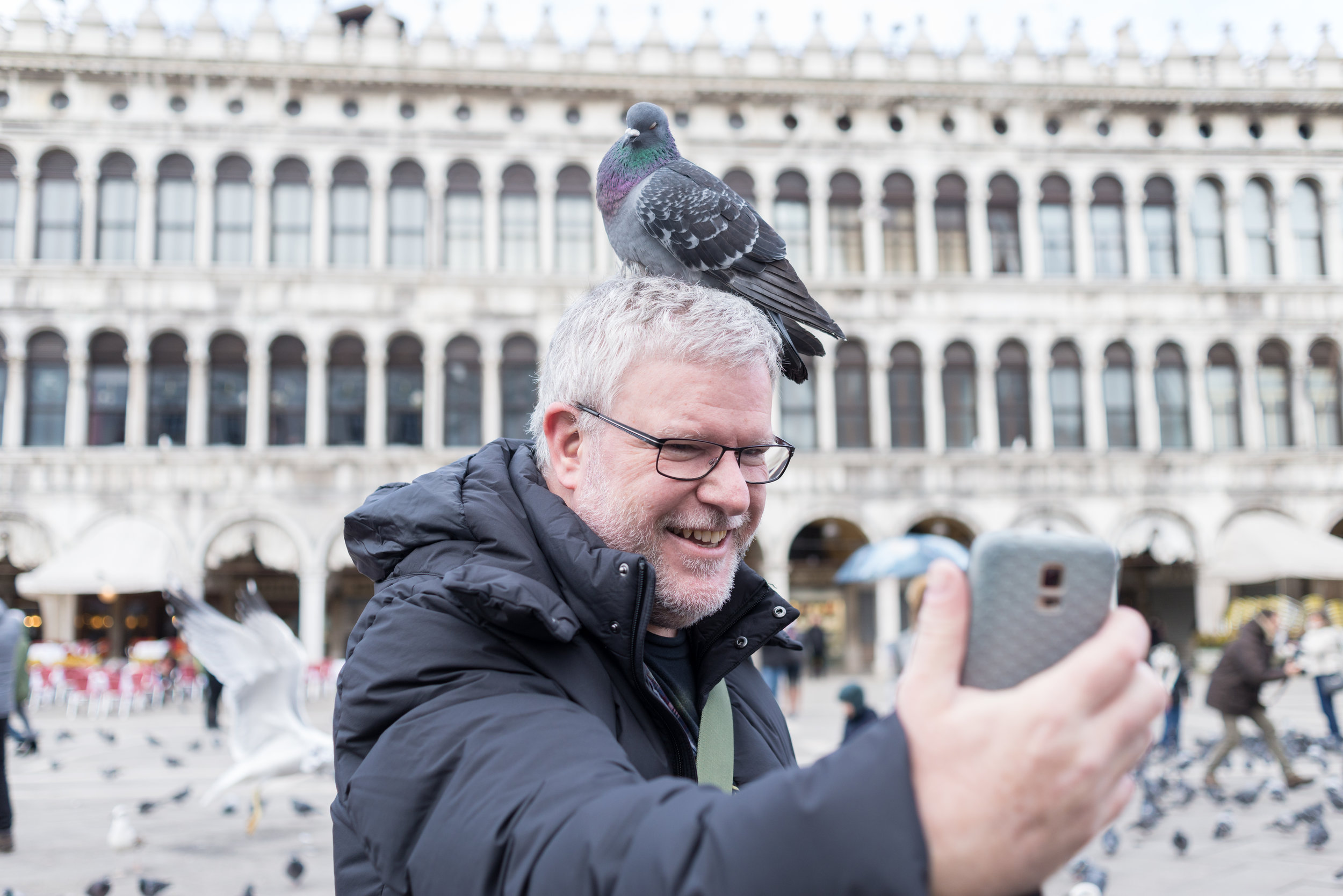 Shane in venice with a pigeon on his head.JPG