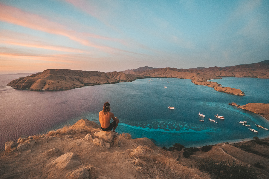Gili Lawa Darat, one of the most breathtaking viewpoints in Komodo National Park. - Jump out of the boat and hike up the hill of Gili Lawa Darat to catch the best sunrise of your life! A 30 minutes trek from beach to the top is needed for a marvelous view. One of the must-visit islands in the park. The perfect place for sunrise… or sunset!