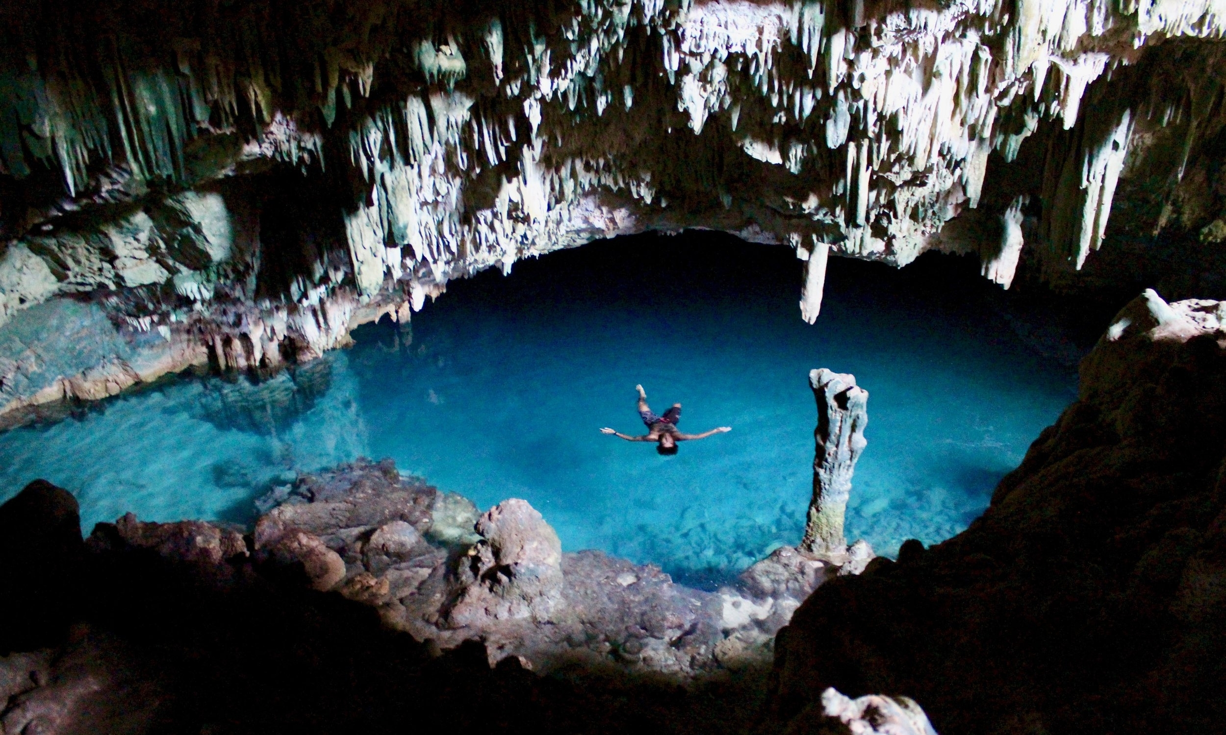 Rangko Cave (Goa Rangko) - Don't leave Labuan Bajo without exploring Rangko Cave and its secret swimming hole filled with crystal clear water. The trip is about 1h by car from Labuan Bajo. You can get to the beach of Rangko Cave from Rangko Village by local boat. The trip takes about 10 minutes. Or take a small boat ride from Labuan Bajo Harbour to reach there directly. Be careful, getting in and out can be very slippery. The best time to visit is during the low tide. Check out the tide times before.