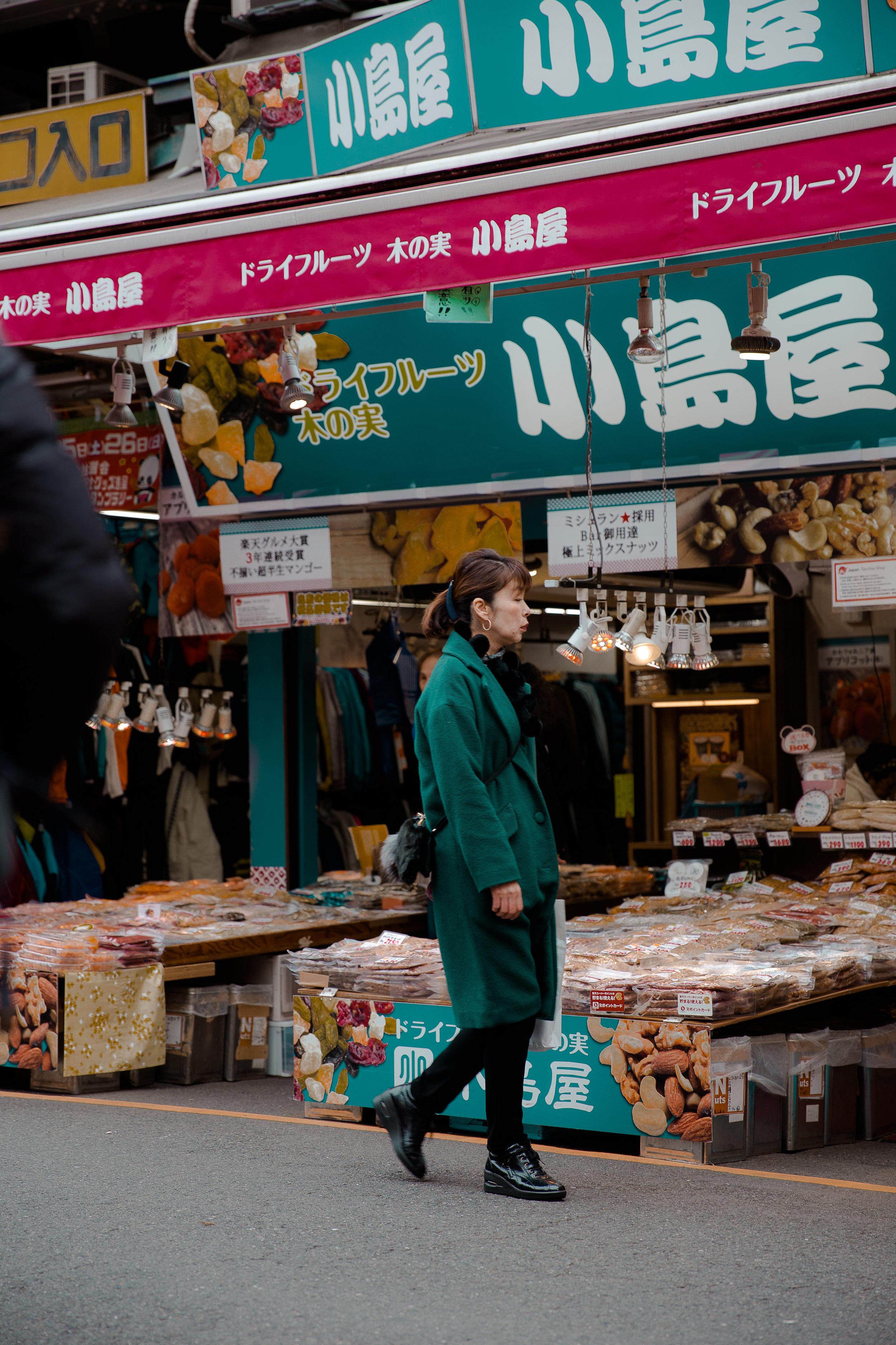 Lady in market. Tokyo, Japan