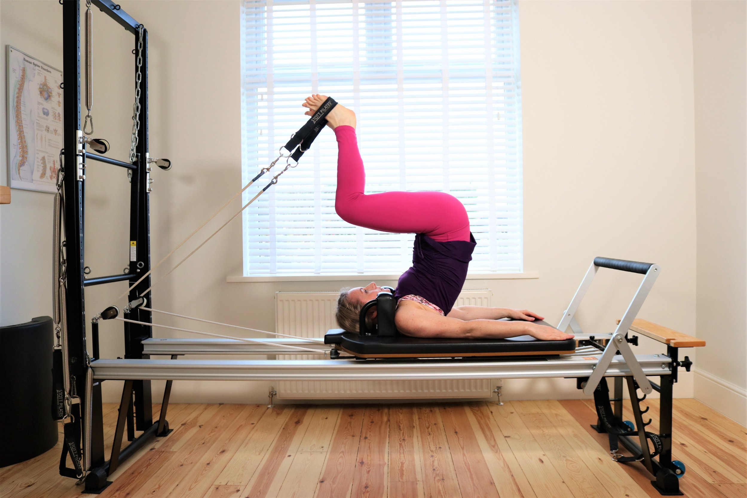 Stretching the spine on the Reformer