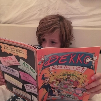 Kid reading Dekko Comics (proof-puddin').jpg
