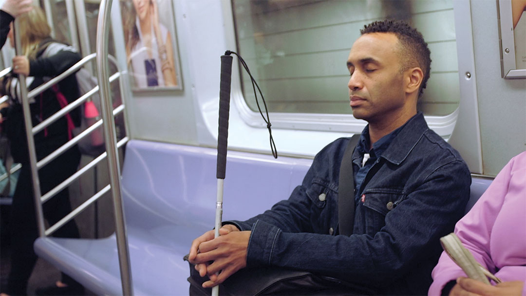visionportraits_rodney_on_train_eyes_closed_credit_kjerstin_rossi.jpg