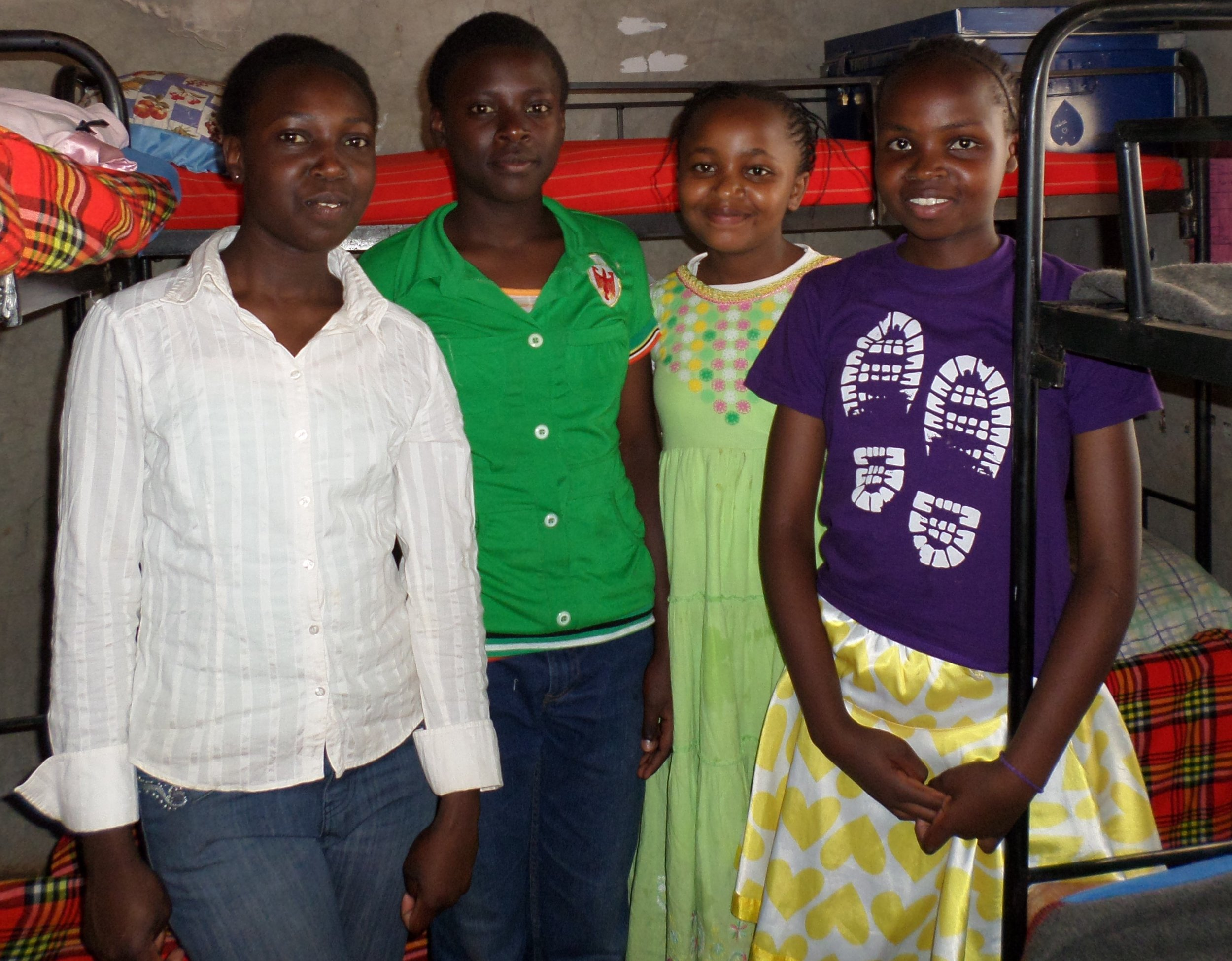 Four girls in their dormitory at Joy Children's Home in Kenya