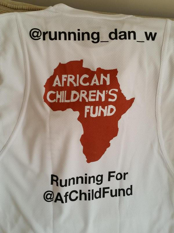 """The back of Dan's African Children's Fund t-shirt featuring his Twitter handle, our logo and confirmation that he is """"Running for @AfChildFund"""""""