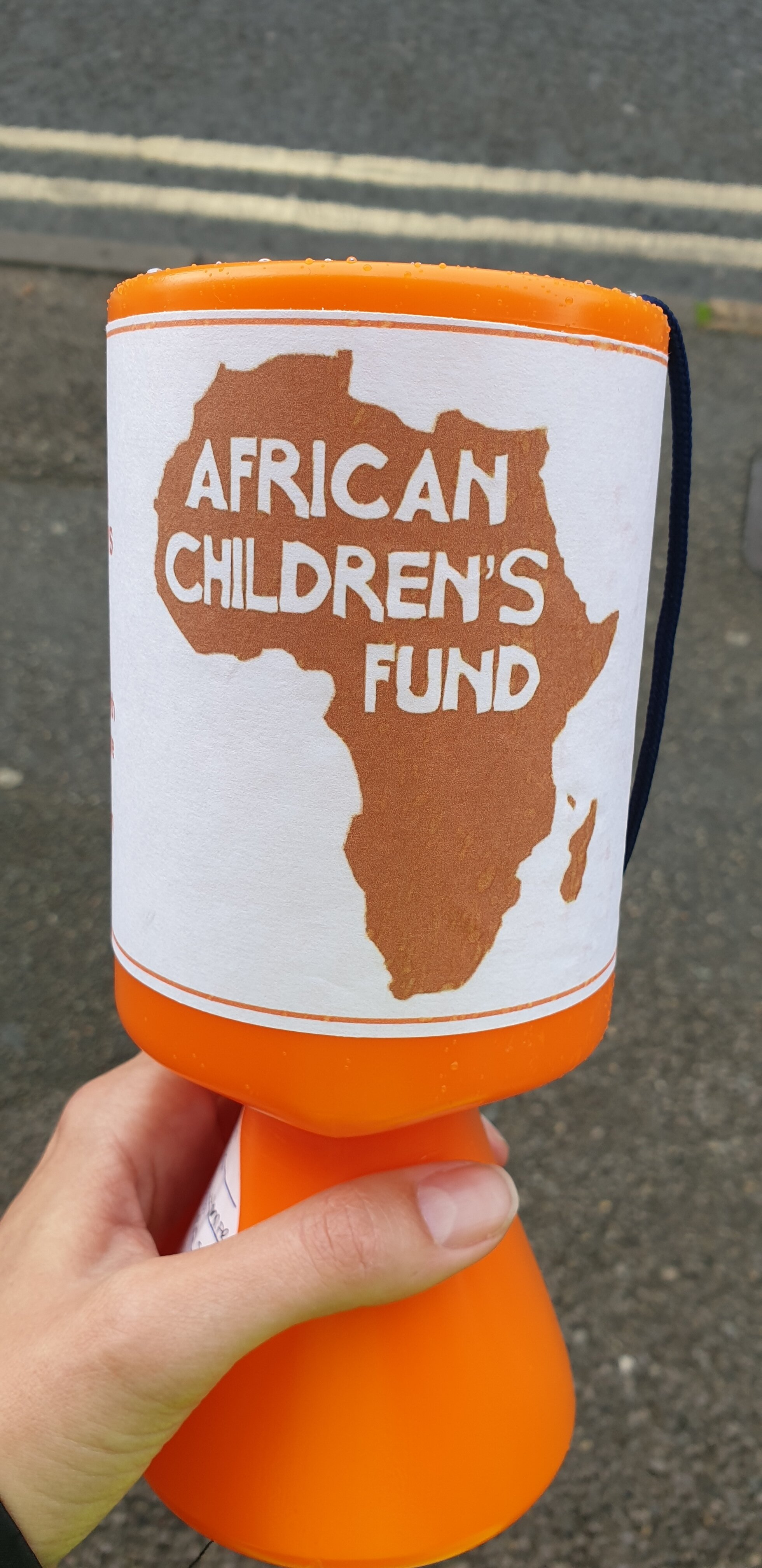 Orange collection box with African Children's Fund label on!