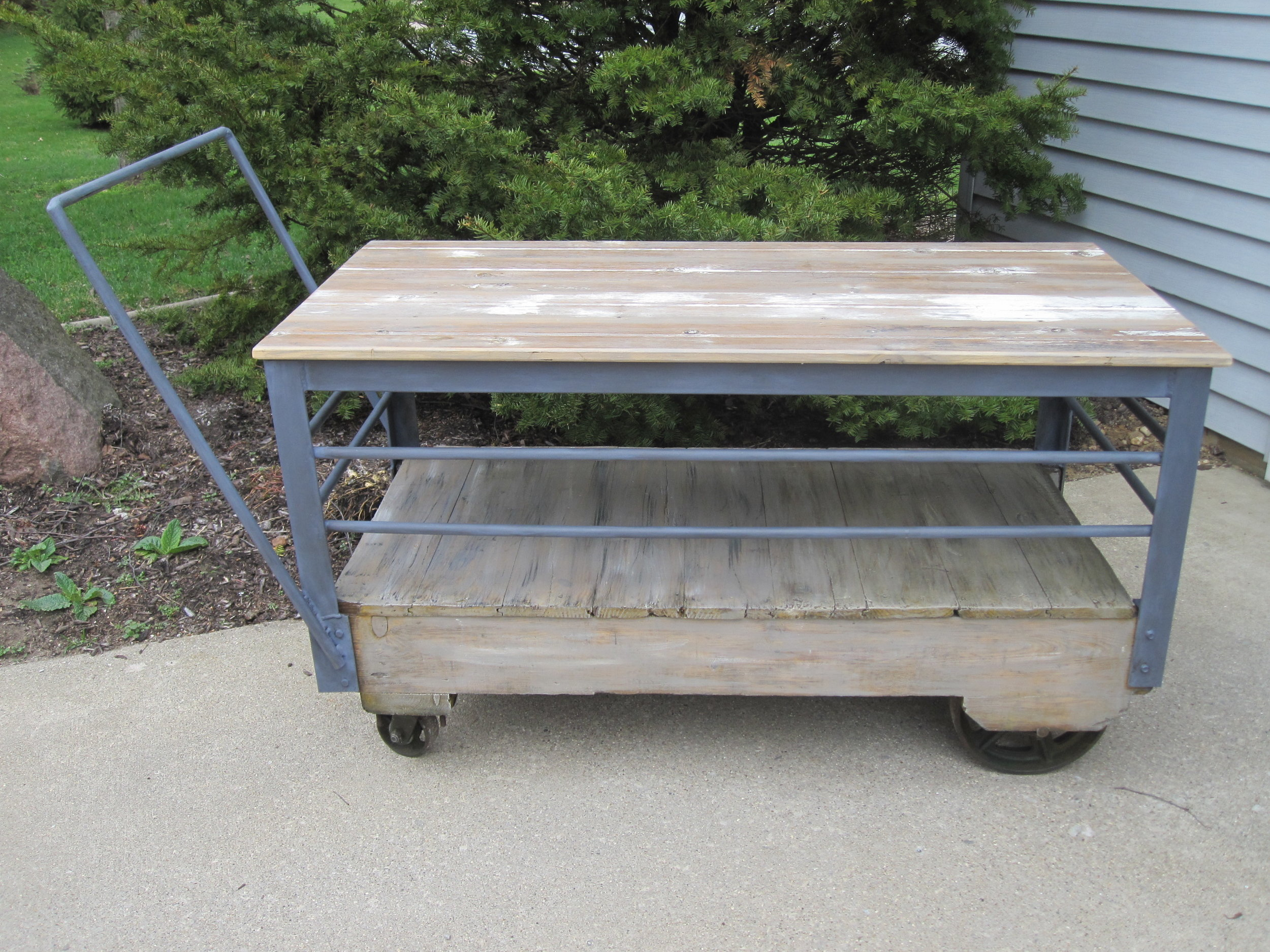 Industrial Cart - Description ~ wood and gray metal industrial cart. Great for gifts, beverage service or other displays. On wheels so easy to move!Quantity ~ 1Rental Price ~ $35