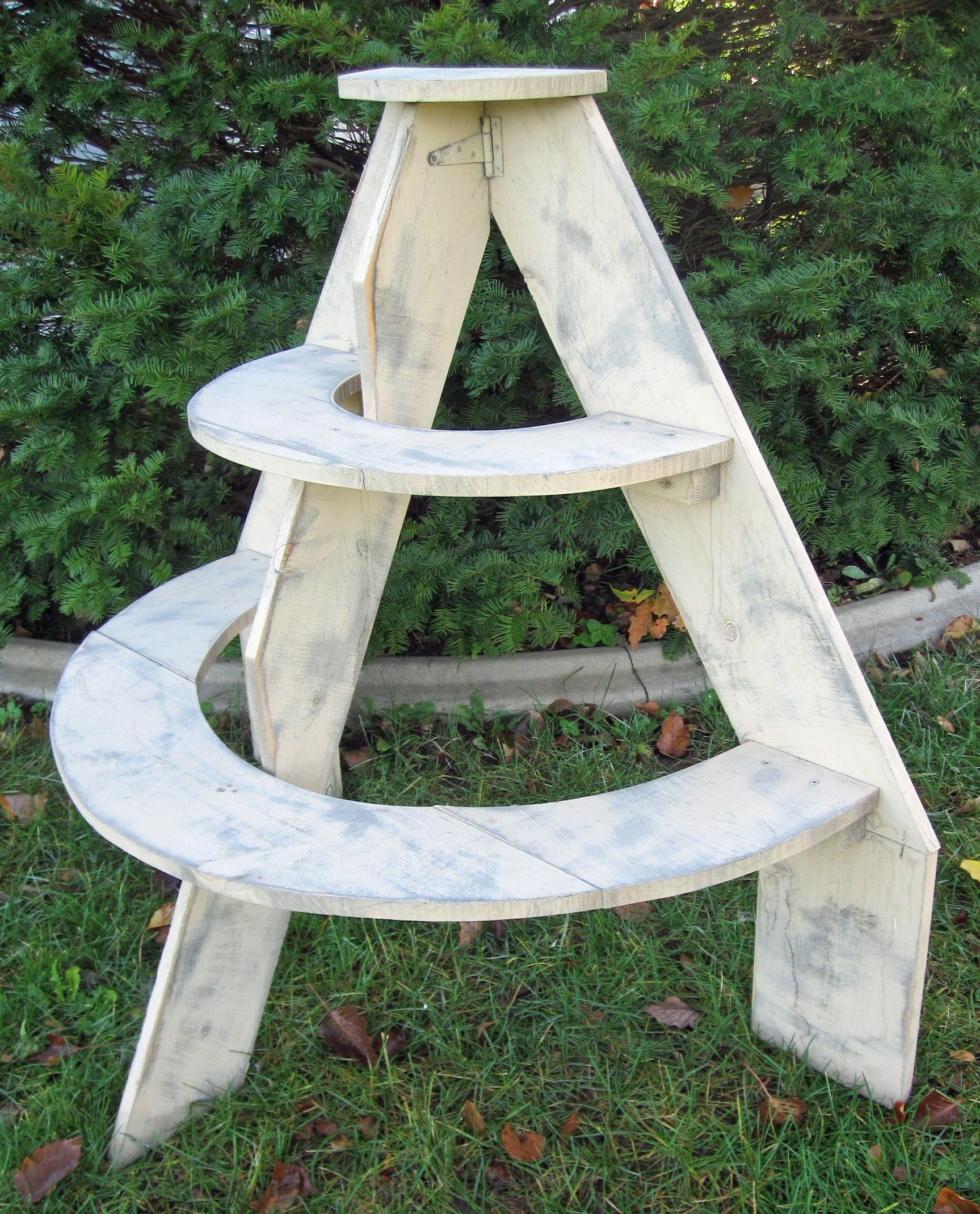 Half Round Shelf - Description ~ rustic half round fits against a wall. Use for photos or favors.Quantity ~ 1Rental Price ~ $20