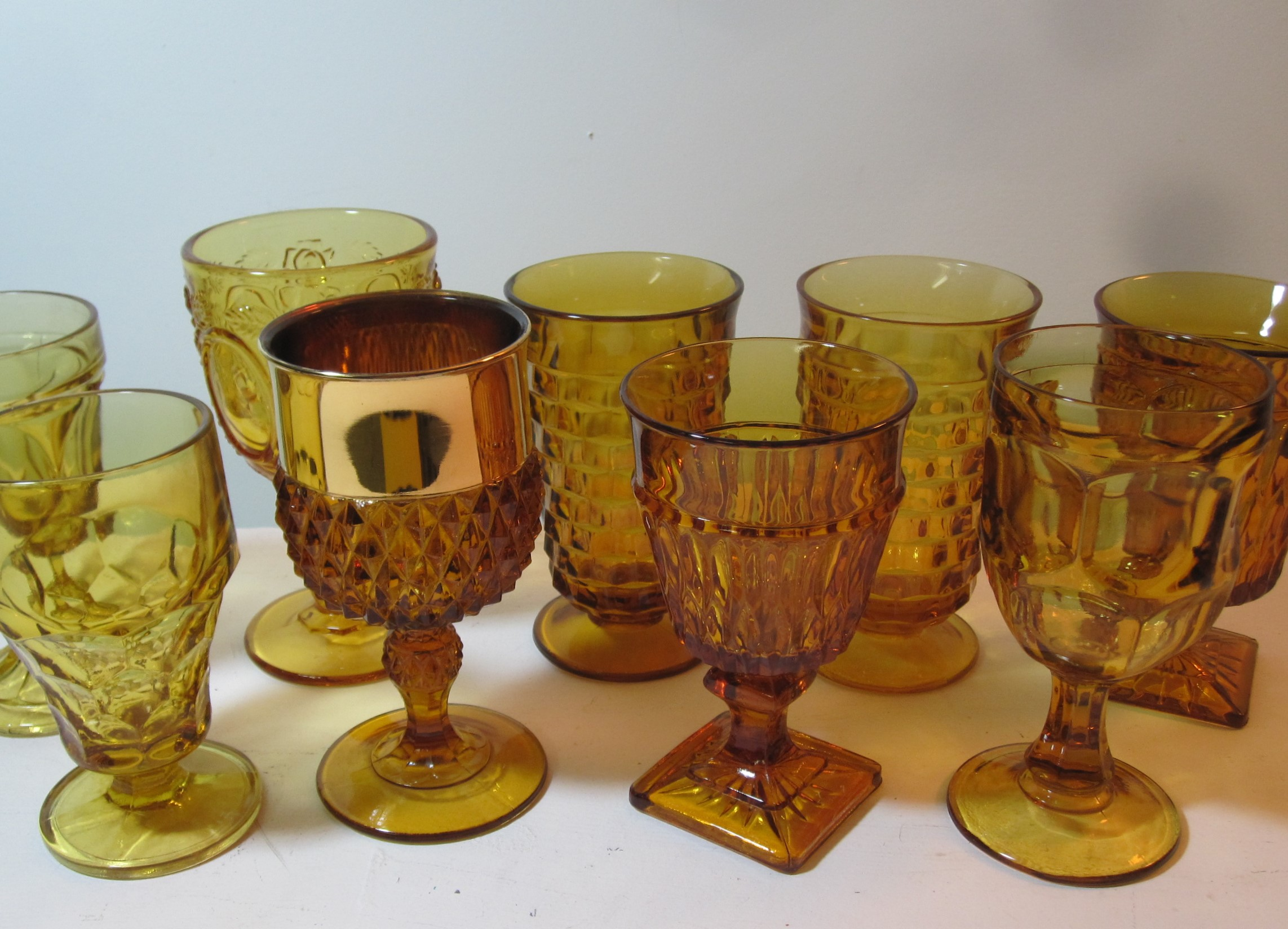 Amber Drinkware - Description ~ An assortment of amber colored beverage glasses. They match nicely with the chinaQuantity ~ 80Price ~ .75