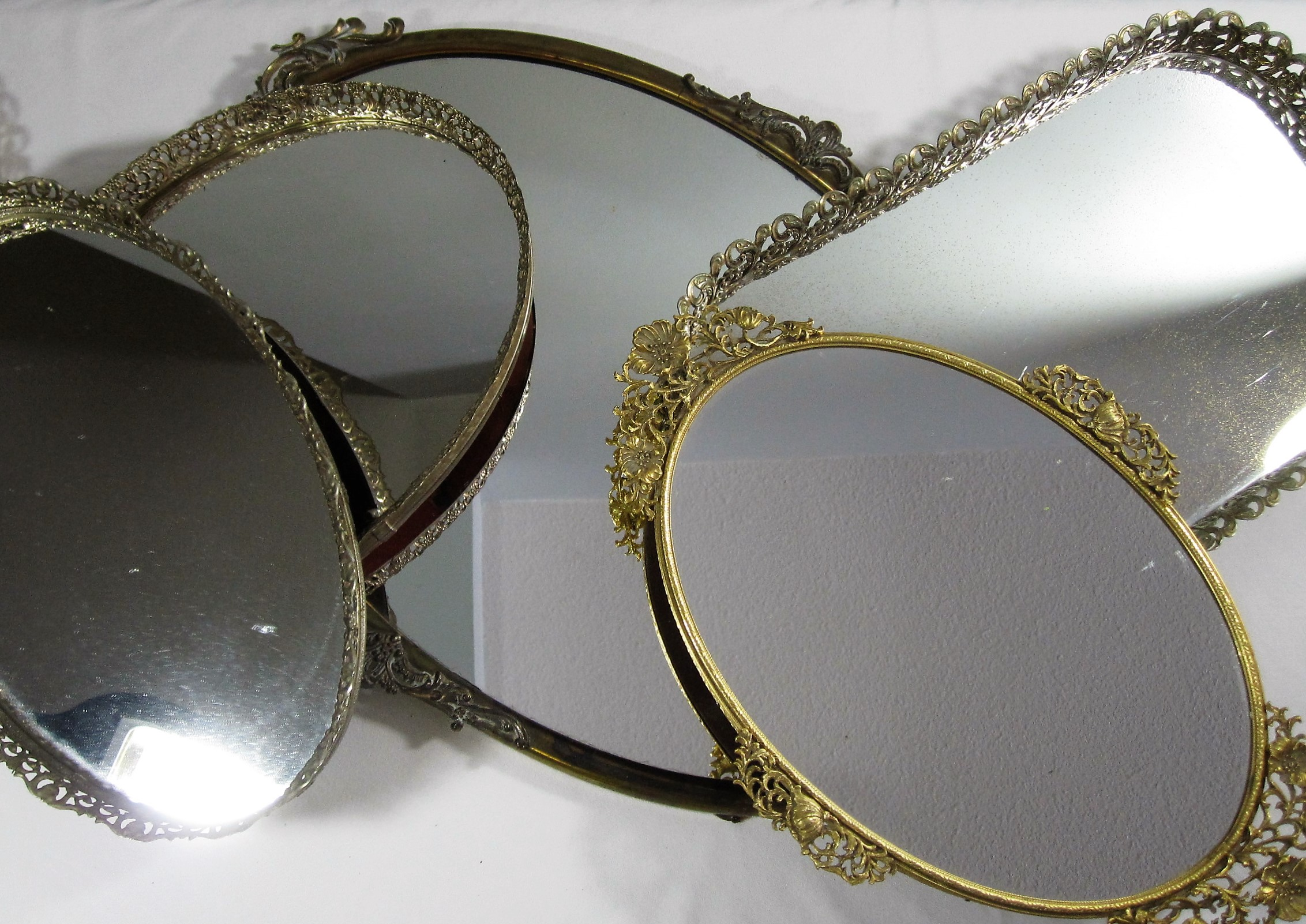Gold Edge Mirrors - Description ~ gold edge dresser mirrors make the perfect display base for candles, flowers or can be used as serving trays for mini dessert or cupcakes. Reflect the beauty of your displays!Quantity ~ 24Rental Price ~ $5 - $8