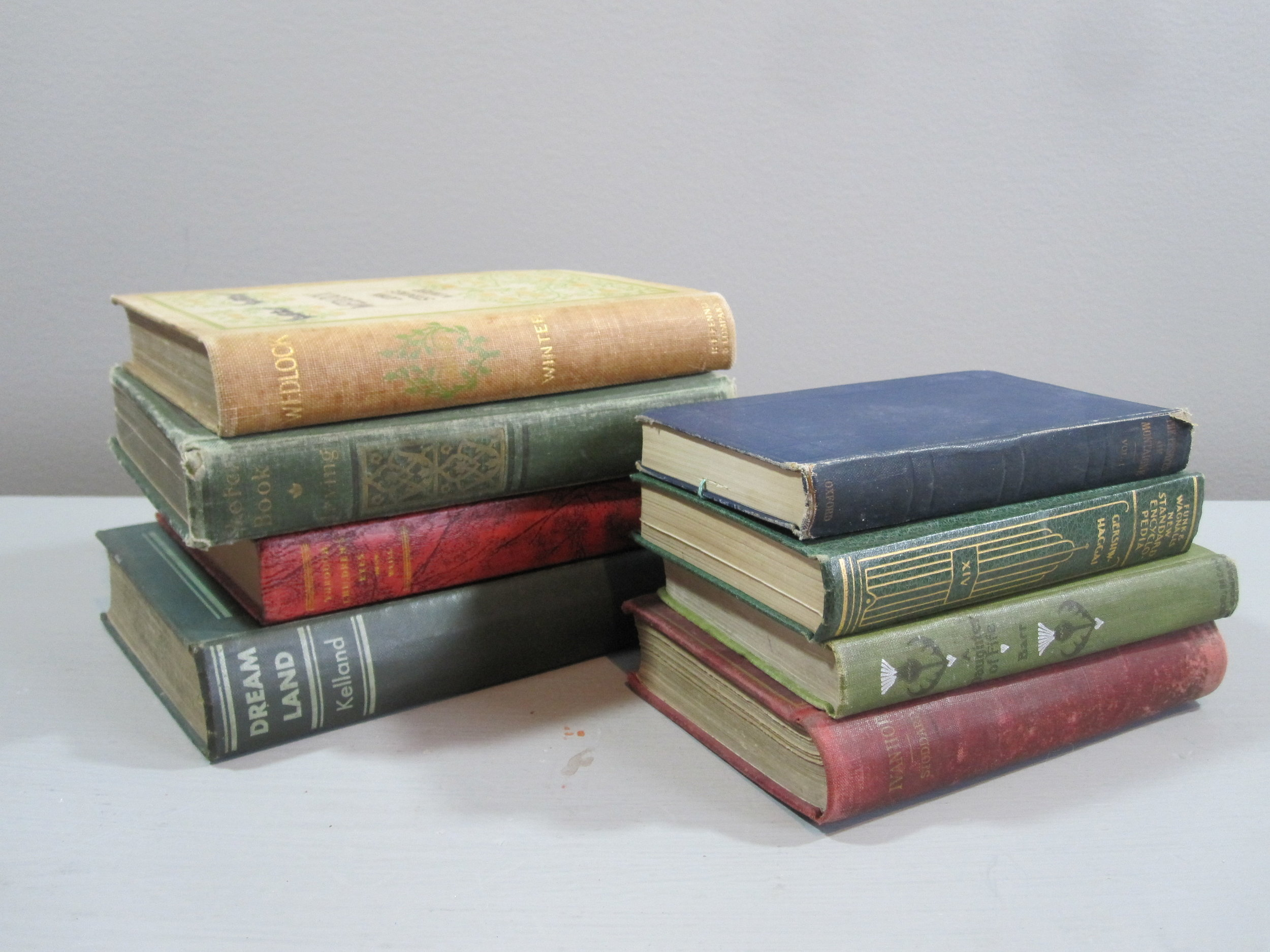 Vintage Books - Description ~ stacked flat they can create new levels for your centerpieces; standing tall they are a display on their ownQuantity ~ 75Rental Price ~ 3 |$2
