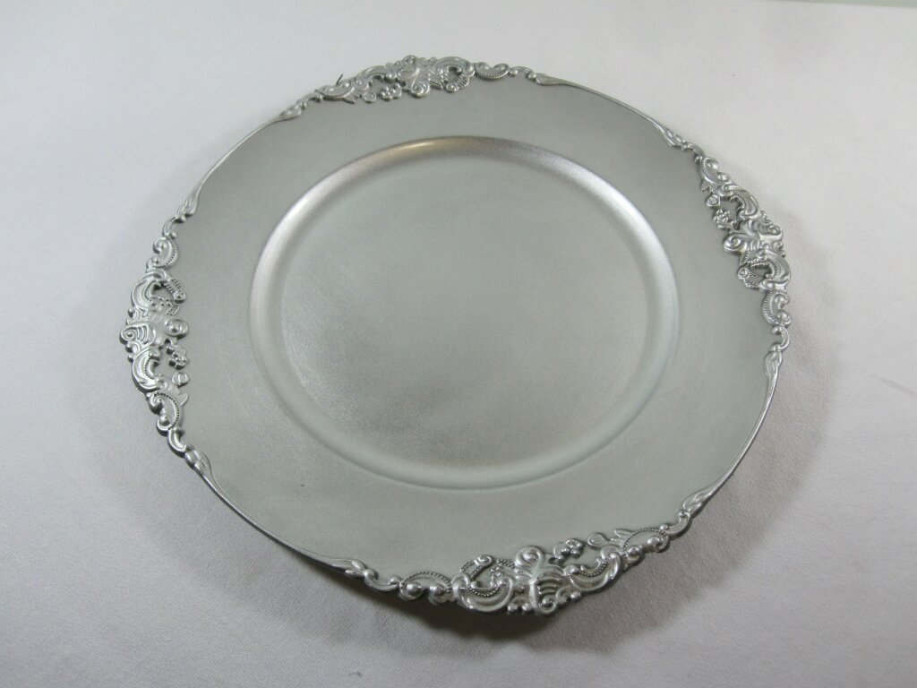 Silver Chargers - Description ~ fancy edge silver chargers. Lovely for the head table!Quantity ~ 25Price ~ $1