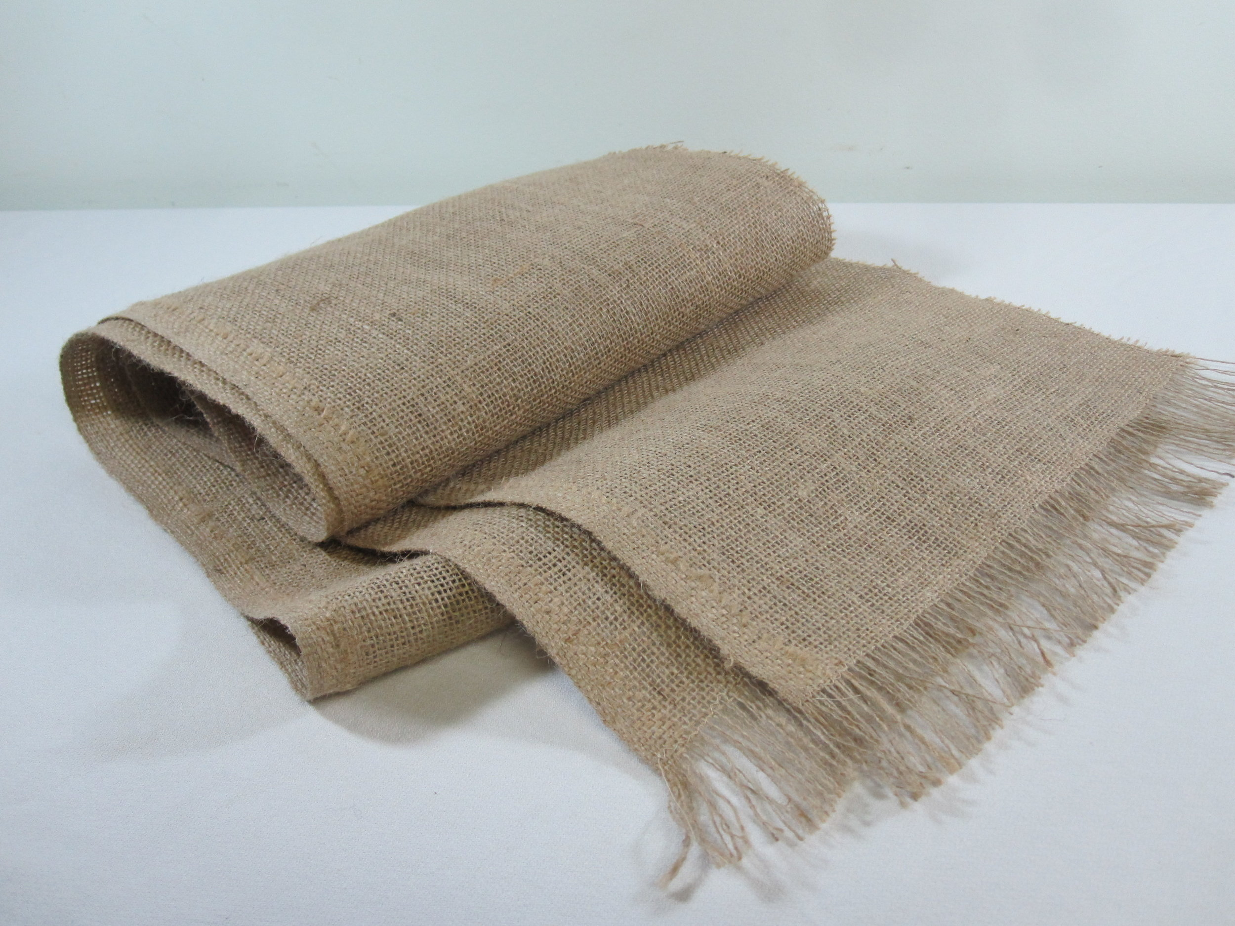 Burlap Runners - Description ~ 6' table runners with fringed ends; smaller quantities of longer runners also availableQuantity ~ 30Price ~ $1
