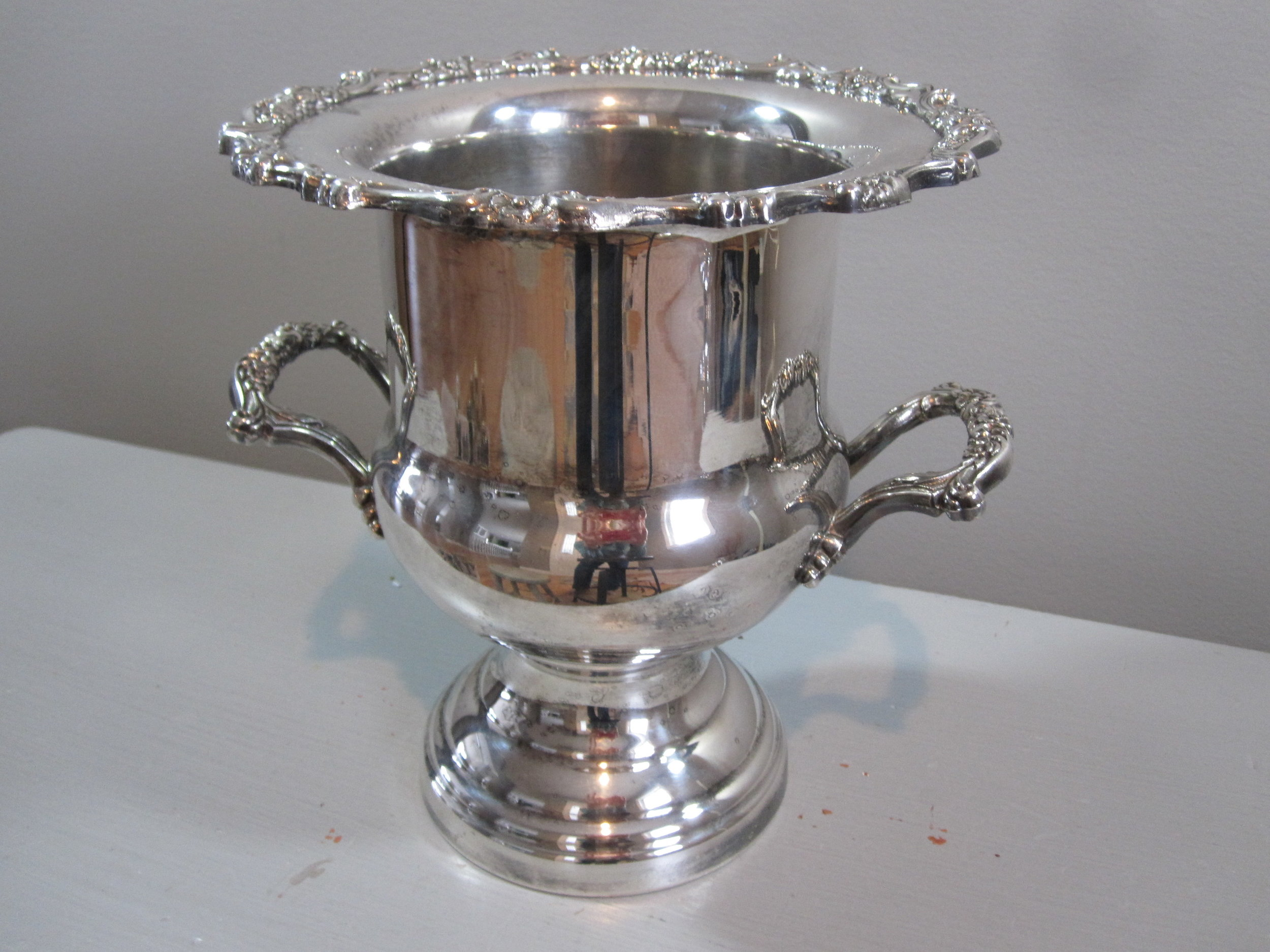 Champagne Bucket - Description ~ silver bucket that holds 1 bottle of wine or champagneQuantity ~ 1Rental Price ~ $12