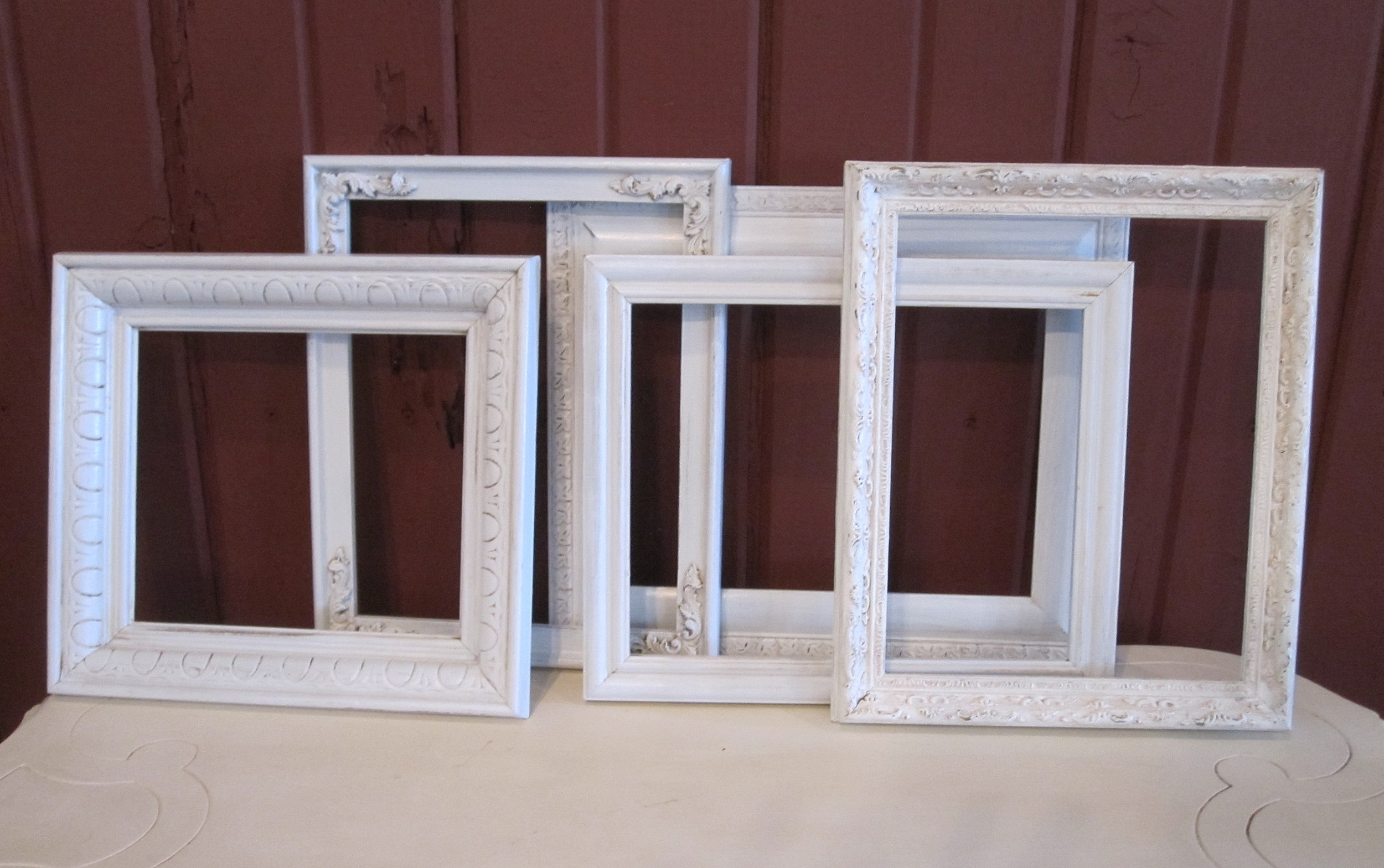 White Frames - Description ~ white open frames can be laid on the table to surround and highlight the centerpiece; several can be used as a traditional frameQuantity ~ 18Rental Price ~ $2
