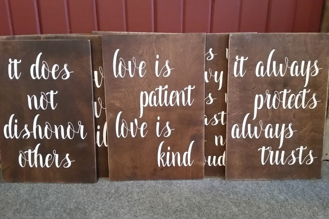 """""""Love is"""" signs - Description ~ set of 8 tiles that display the verses in the I Corinthians 13 """"love chapter"""". They work well placed along the aisle or in other settings as well.Quantity ~ 1 setRental Price ~ $30"""