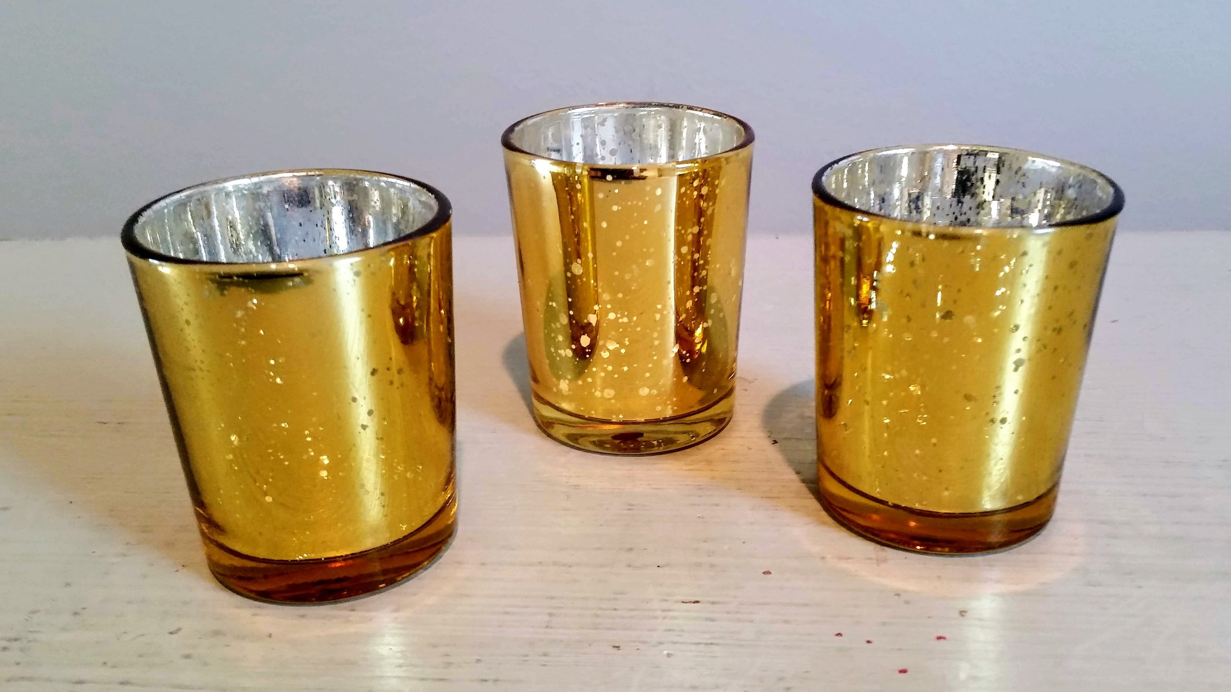 Gold Mercury Votives - Description ~ gold mercury glass holders for votive candles or tealightsQuantity ~ 144Price ~ .50 each