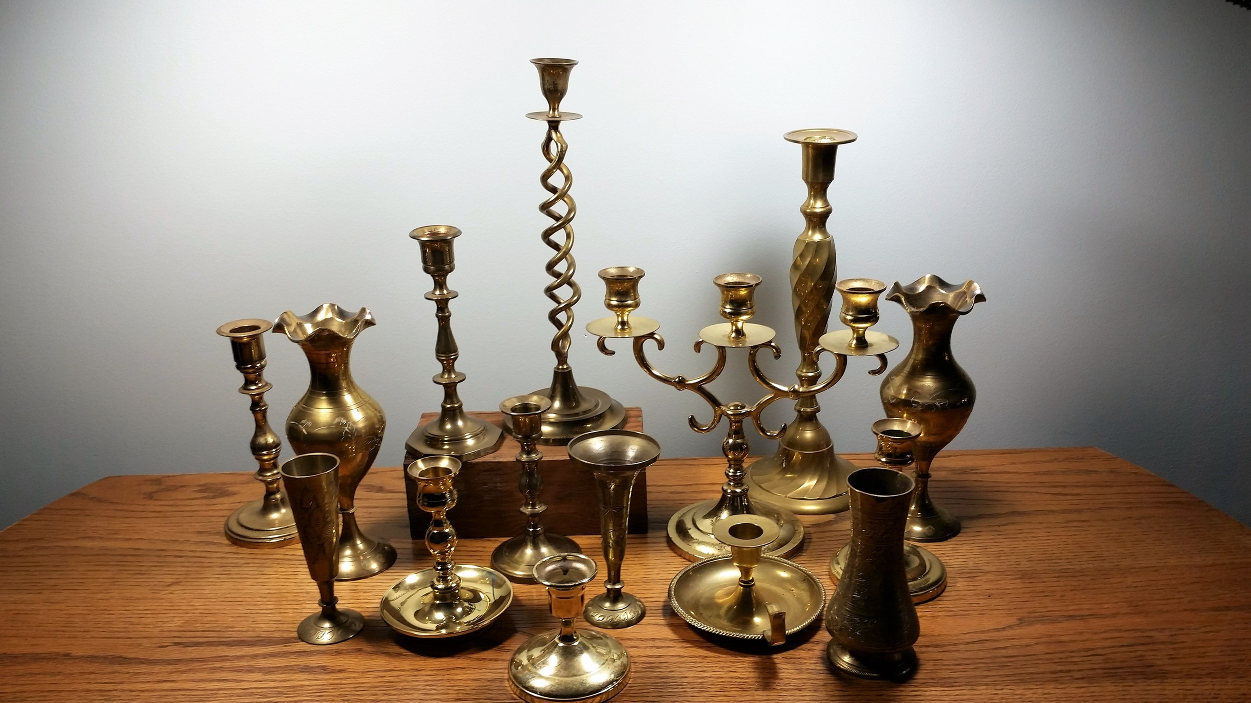 Brass candlesticks - Description ~ candleholders in a variety of heightsQuantity ~ 40+Price ~ $1 - $5
