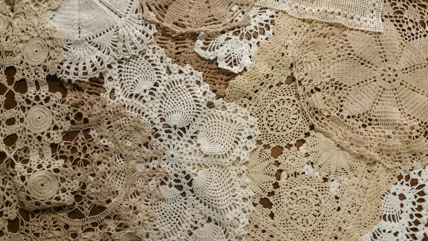 Doilies - Description ~ variety of shapes, sizes & colors; use on tables or other displaysQuantity ~ manyPrice ~varies by size