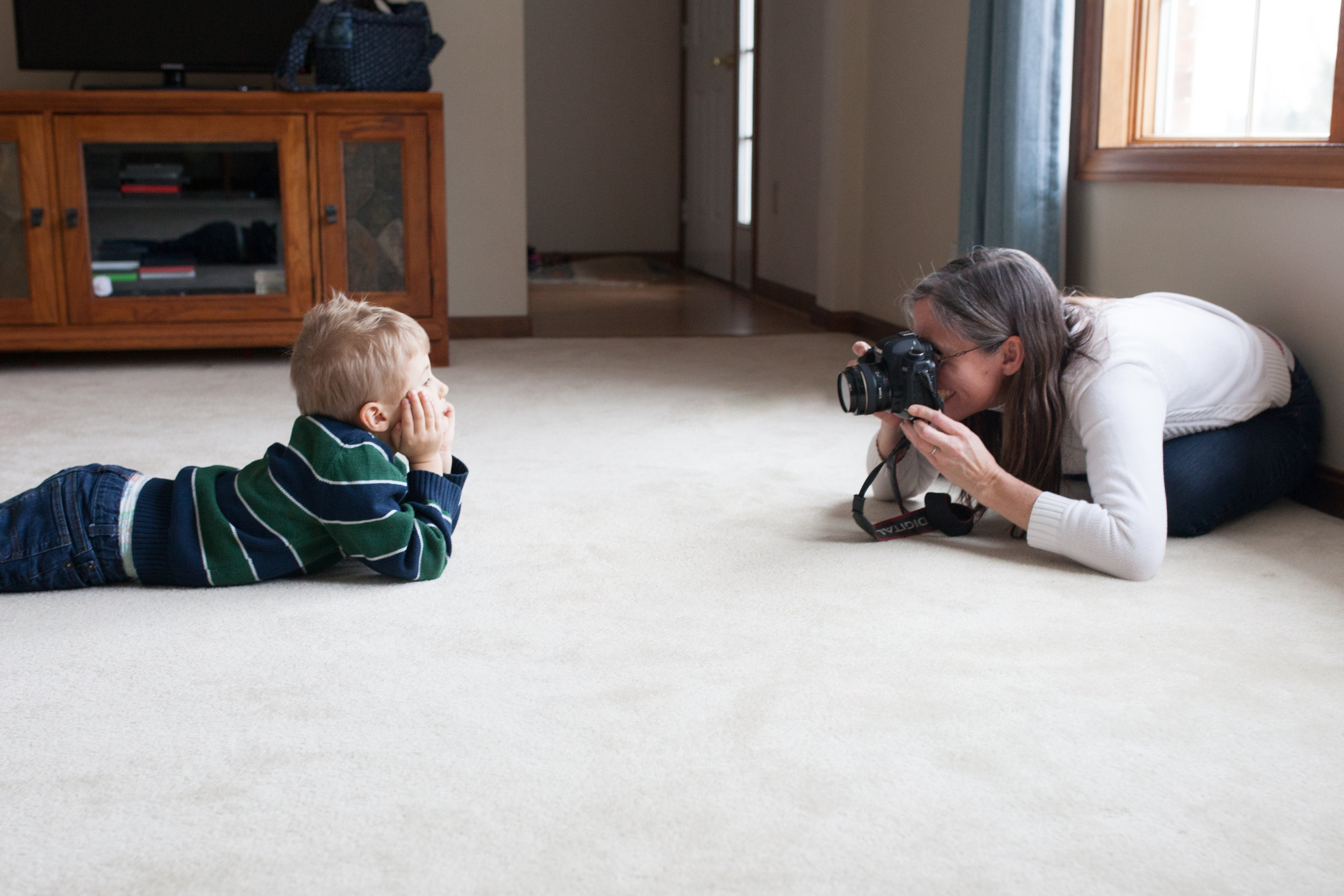 Pittsburgh Family Photographer Jenny Stein photo of boy being photographed in his home