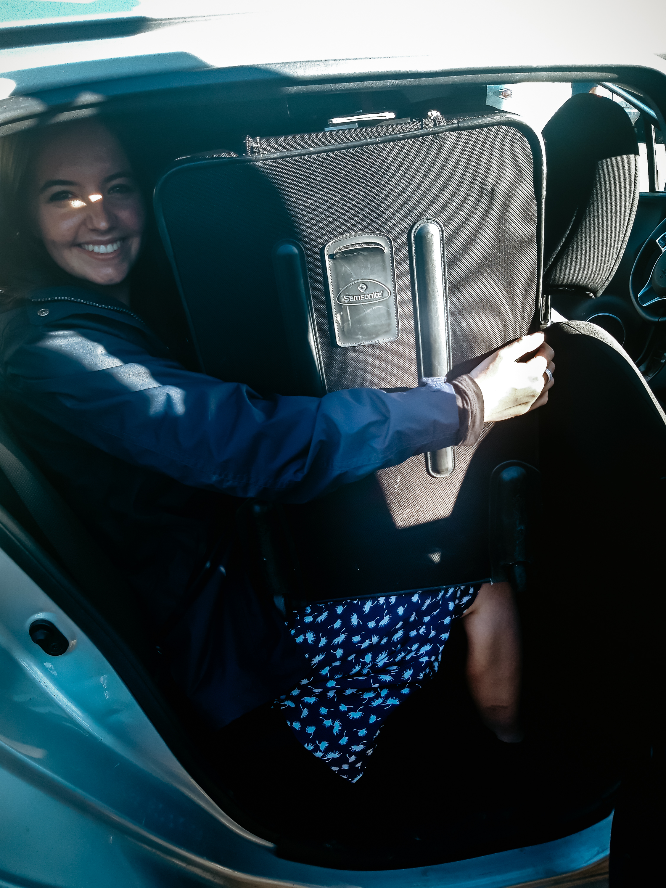 us trying to fit 6 suitcases in poor lil gina