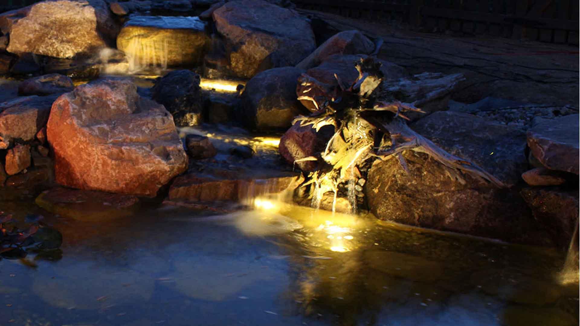 Auburn-Sky-Landscaping-Nighttime-Lighting-Waterfeature-Driftwood.jpg