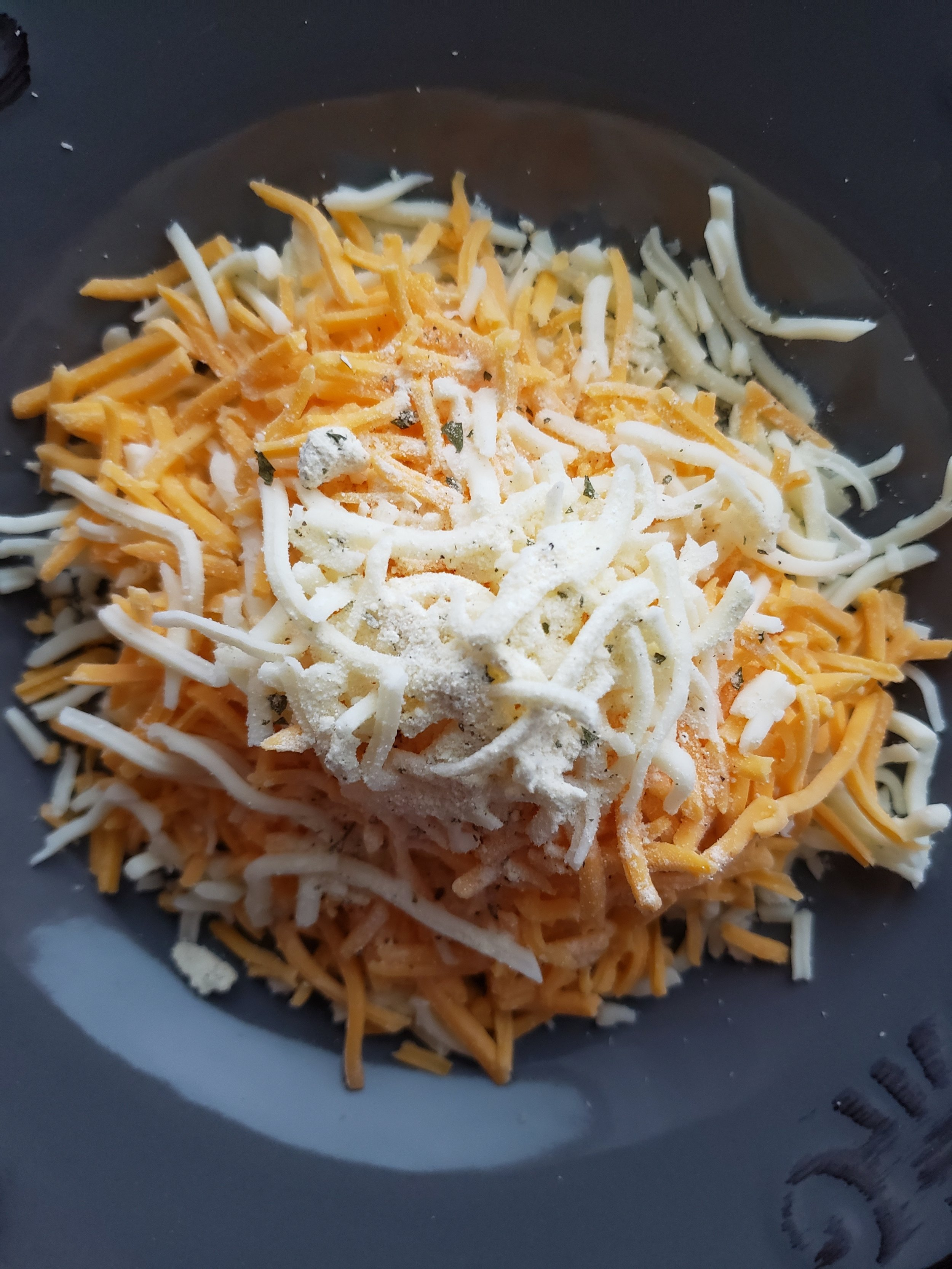 In a bowl mix whatever cheese and seasonings you want! Here is shredded cheddar, mozz, and dry ranch mix.