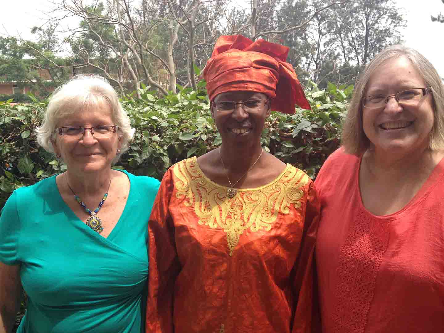 Cairn with her twin at University of Rwanda with the Nursing Dean.JPG