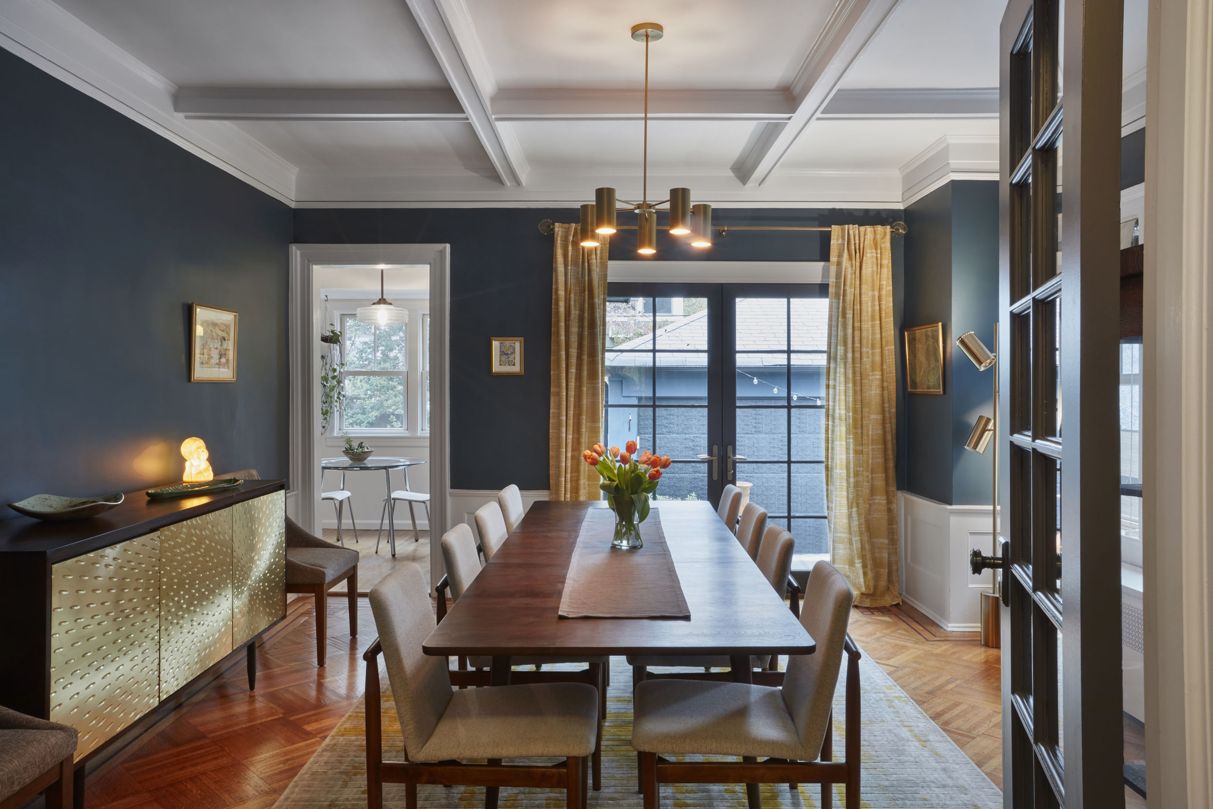 """Westminster - Year: 2016Type: ResidentialLocation: Brooklyn, NYSquare Footage: 3,386Scope of Work: Architectural and Interior DesignA couple from Ditmas Park, Brooklyn—who both work in advertising—had won a free two hour consult with Foz Design at a charity auction, during which they thought they'd simply """"discuss pillows."""" Far from it, as that meeting was the kick off to a full-scale contracted renovation project that had to reflect not just the eclectic personalities under its roof, but also the neighborhood they'd come to call home.Ditmas Park, well known for its Victorian architecture, complete with front and back yards, has become inhabited by an increasingly multi-cultural demographic. Similarly , we were able to come up with solutions that beautifully blended a variety of design genres, both inside and out.On the exterior, forms were kept traditional while finishes including paint and window trims were changed to give the architecture a more modern twist. Leading out to the patio and backyard is a new set of French doors that were added in the dining room, allowing for more natural light to enter the home.On the inside, styles such as Mid-century modern flow seamlessly with touches of ethnic elements as well as bright splashes of color and engaging print and pattern. The basement, previously only used for storage and laundry, was turned into a rec room for their two sons, allowing for a more formal living room upstairs. And the entire project was topped off by selecting the pillows that sparked our working relationship more than a year ago."""