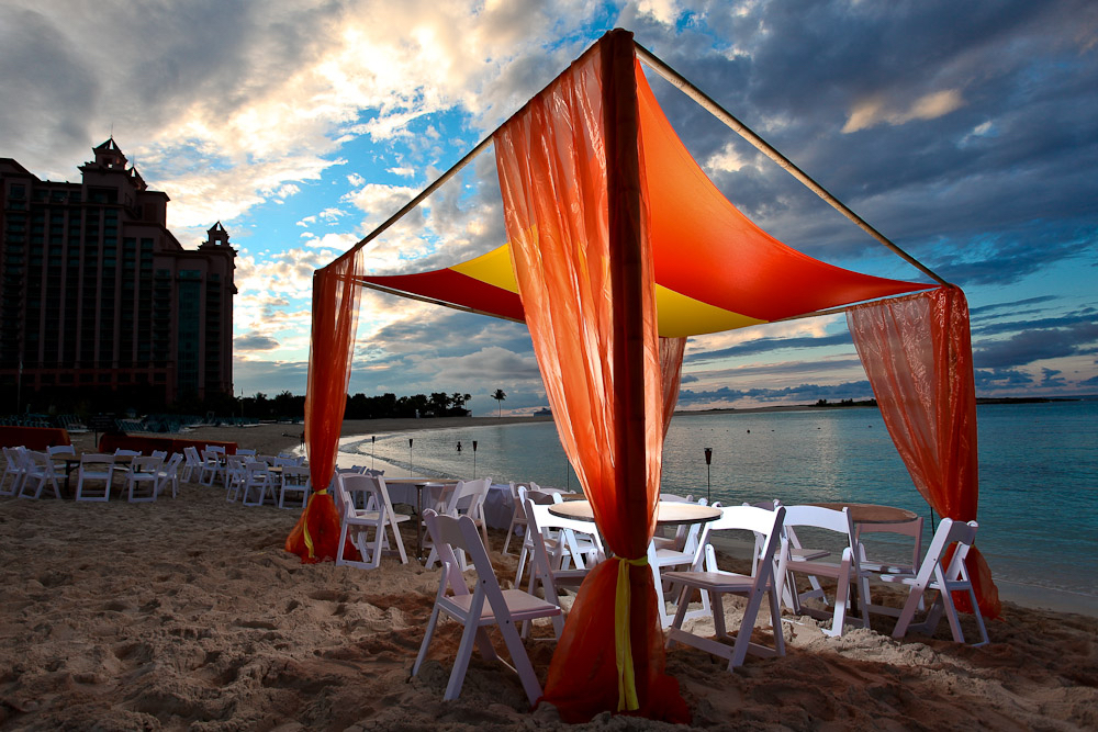 orange fabric decor for beachfront event.jpg