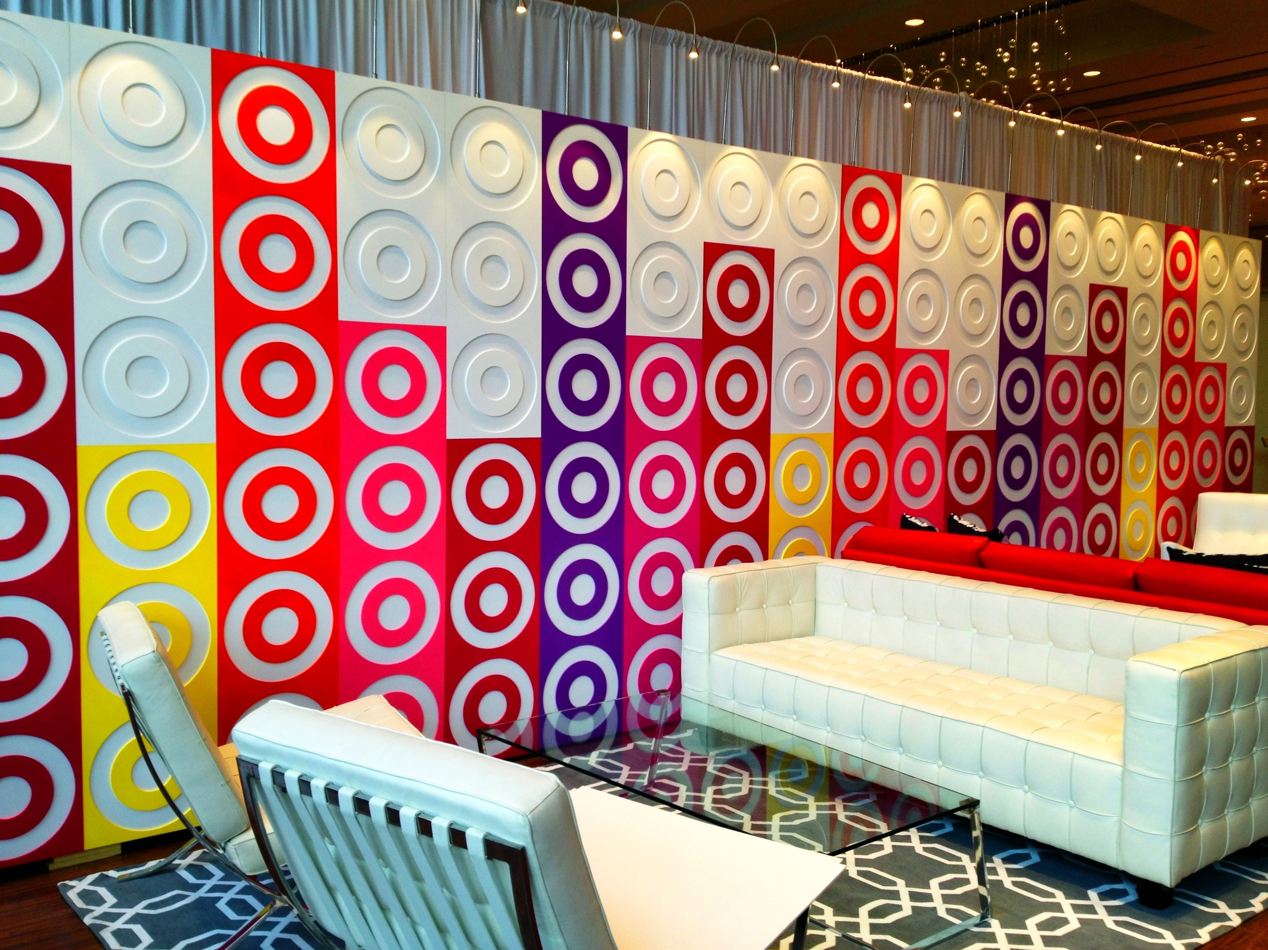 Target lounge with branded wall in bright colors.jpg