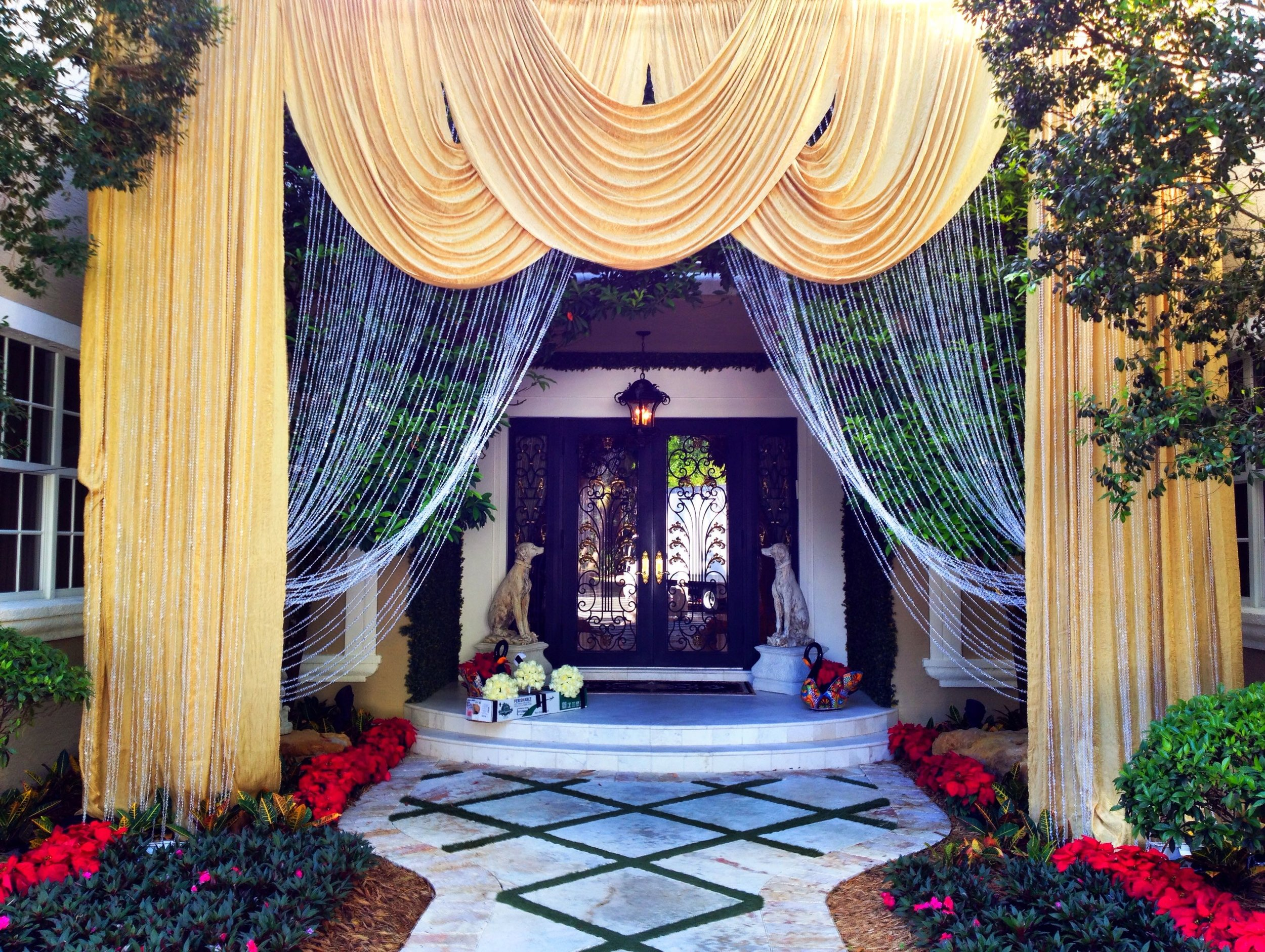 Gold drape and swags with beaded curtain.jpg