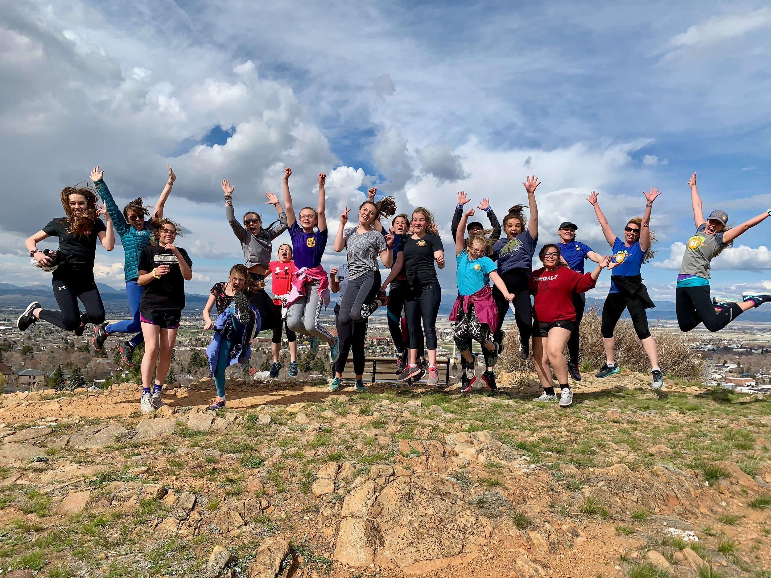 Girls and coaches celebrate running to the top of Daisy Hill Trail! -