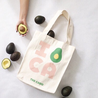 This handmade tote was one of the first physical pieces of The CADO brand (designed by @cristiestevens). ⁣ ⁣ We love that each person who carries it is not only expressing their love of CA's favorite fruit, but they are also supporting the woman who made it. Each tote is signed by its maker and helps empower women in Kenya through @imanicollective. ⁣ ⁣ You can find the bag at @thecado.co in San Marcos (through tomorrow, 9.22) or online. Link in bio. ⁣ ⁣