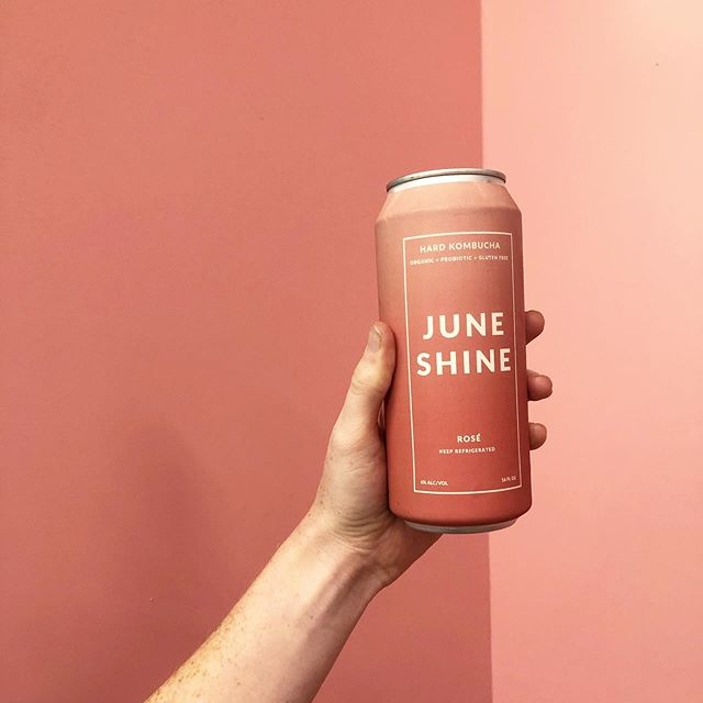 Casually matching our beverages with our walls. Anyone else obsessed with the new rosé kombucha from @juneshineco?