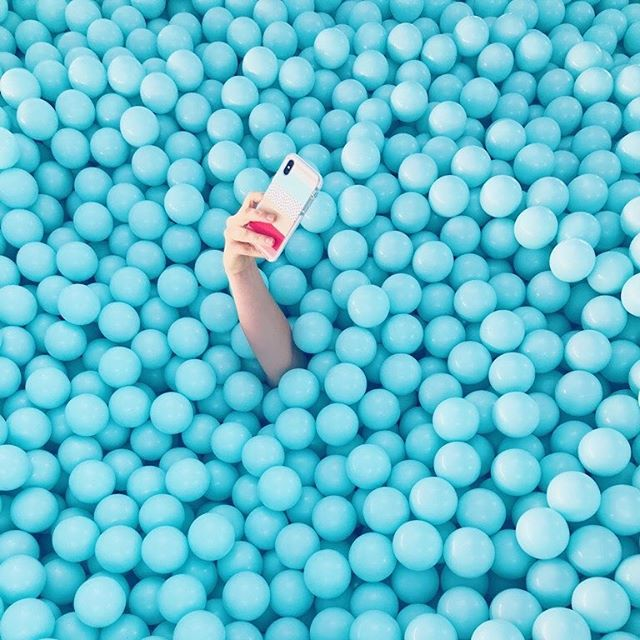 Nostalgia + grammability = the law of Millennial attraction.  Ball pits have made a major comeback. But for grownups. This one from Color Factory NYC is the most gorgeous one we've seen. It follows the trend in returning to childhood games (ala kid-free summer camps, arcade bars, coloring books, etc) as experiences or escapism.  Read up (link in bio): A Brief History of the Ball Pit on @voxdotcom . . . . . . . #colorfactory #ballpit #experience #selfie #installationart #experiential #blue #creative #create #installation #popup #nostalgia #millennials
