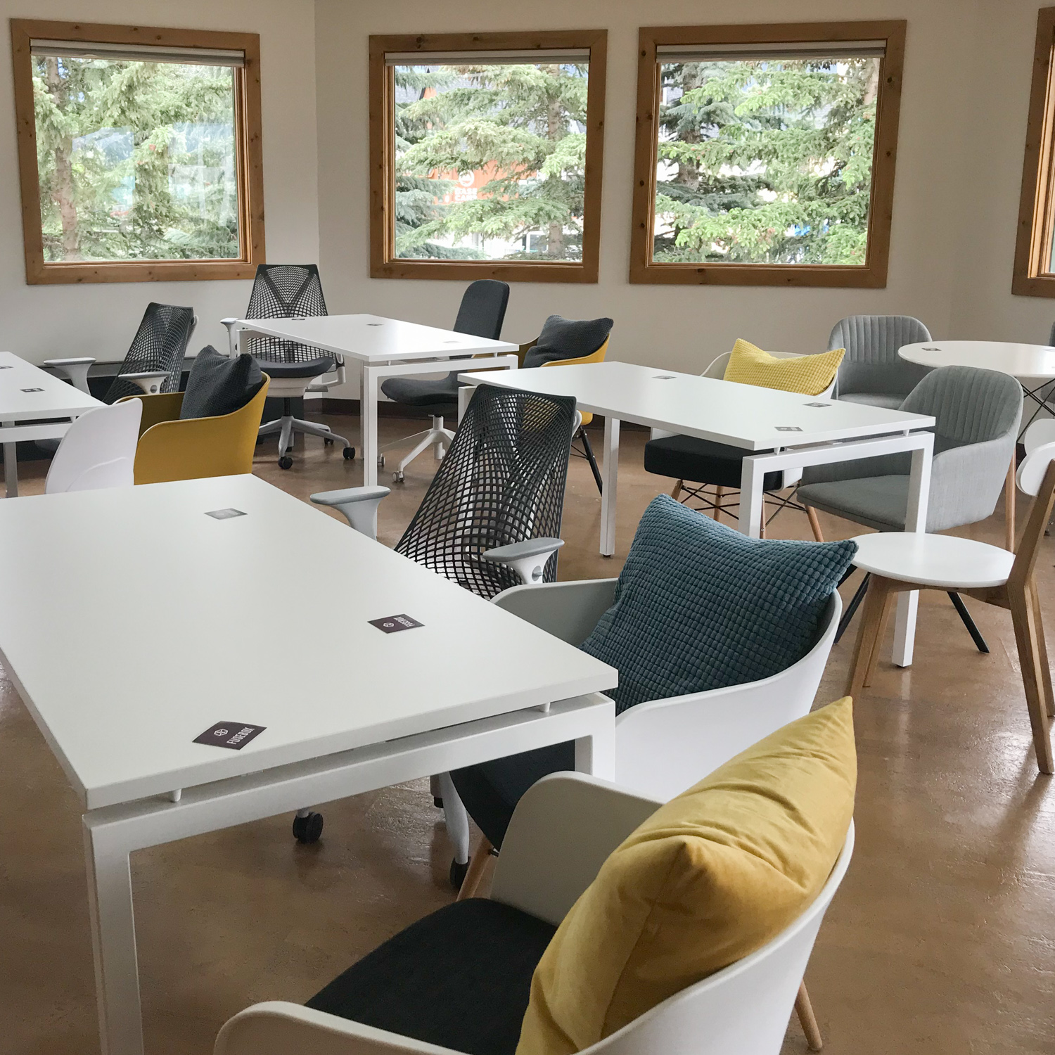 Octagon Studio - Our most adaptable option for larger gatherings. We can accommodate about 30 people seated depending on your requirements. This bright and spacious studio will be set up to your specs as a classroom, boardroom, open concept, photo studio or to suit.-10 windows with spectacular mountain views- Tables and chairs included-55