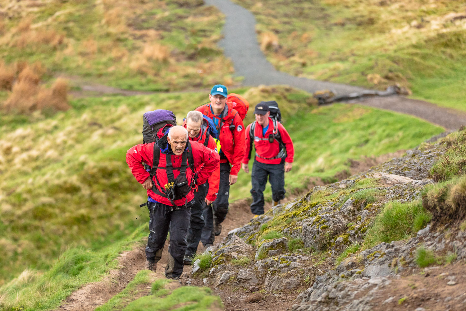The mountain rescue service on their way to the Dumyat summit