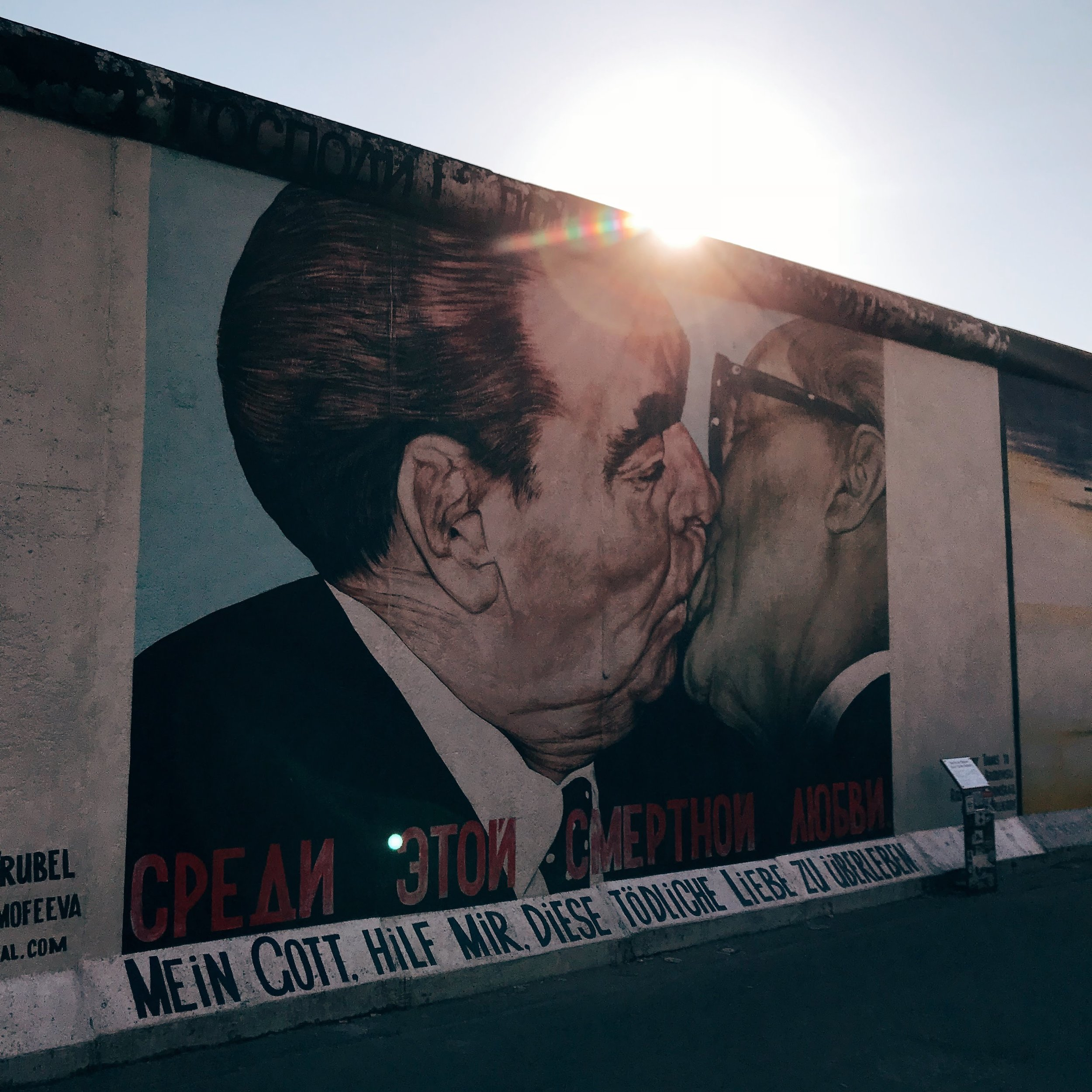"""Famous """"My God, Help Me to Survive This Deadly Love"""" or """"Socialist Fraternal Kiss"""" graffiti painting at East Side Gallery"""
