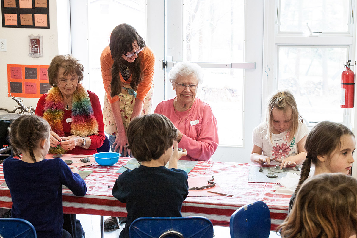 Kindergartners and elders from Thorpe Senior Center enjoy making pottery together as part of our Intergenerational Ceramics Program.