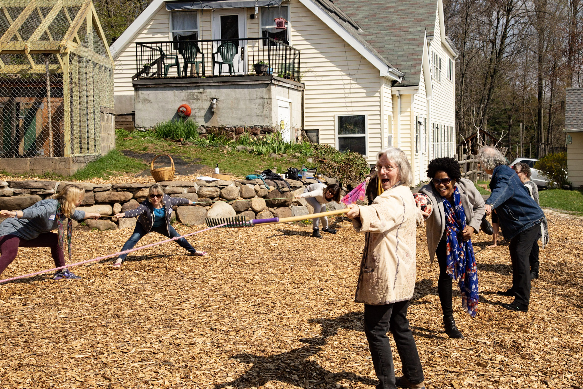 Participants had to plan and work together to make a bridge across the woodchips with some objects.